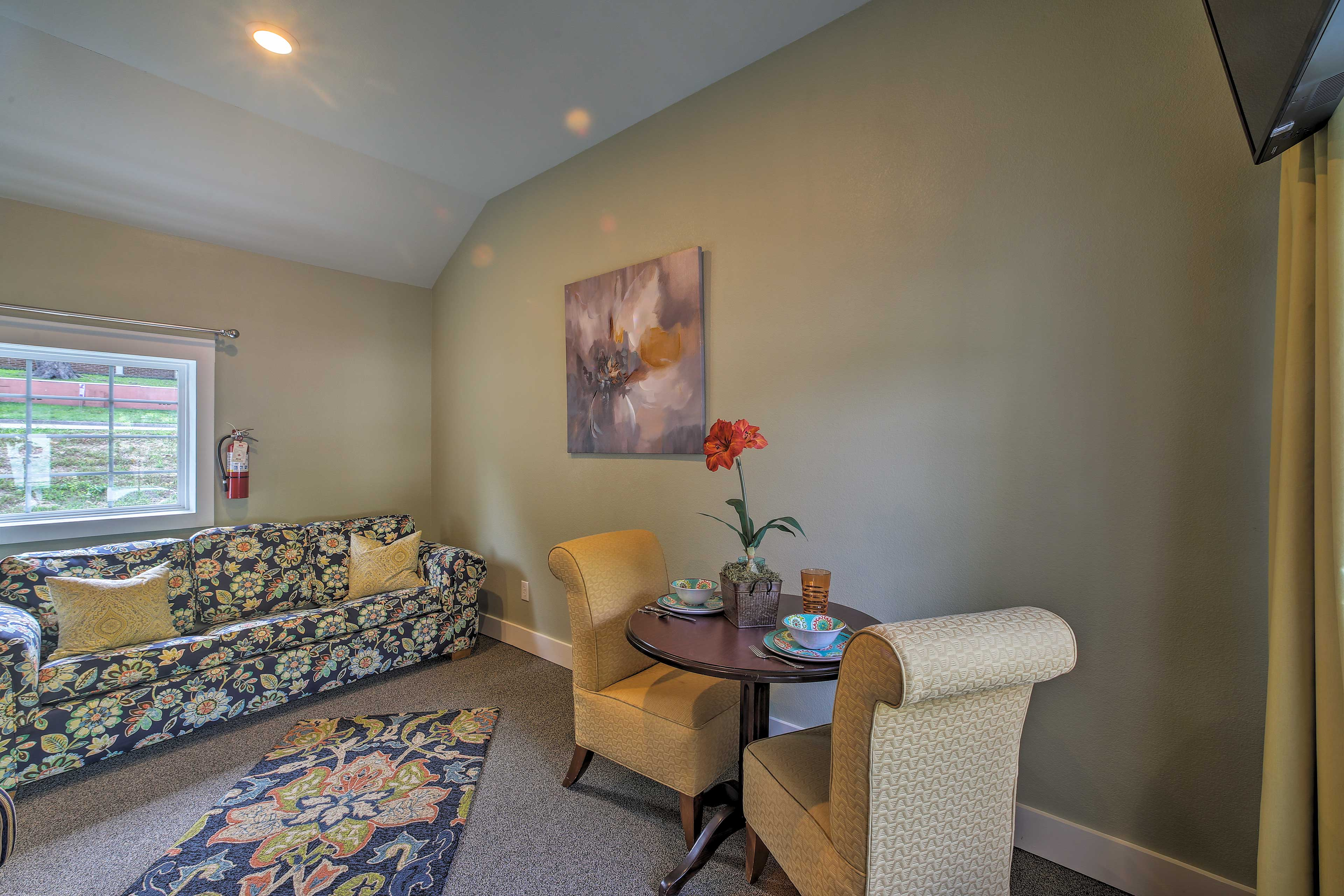 The cozy living room has high ceilings and high-end finishes.