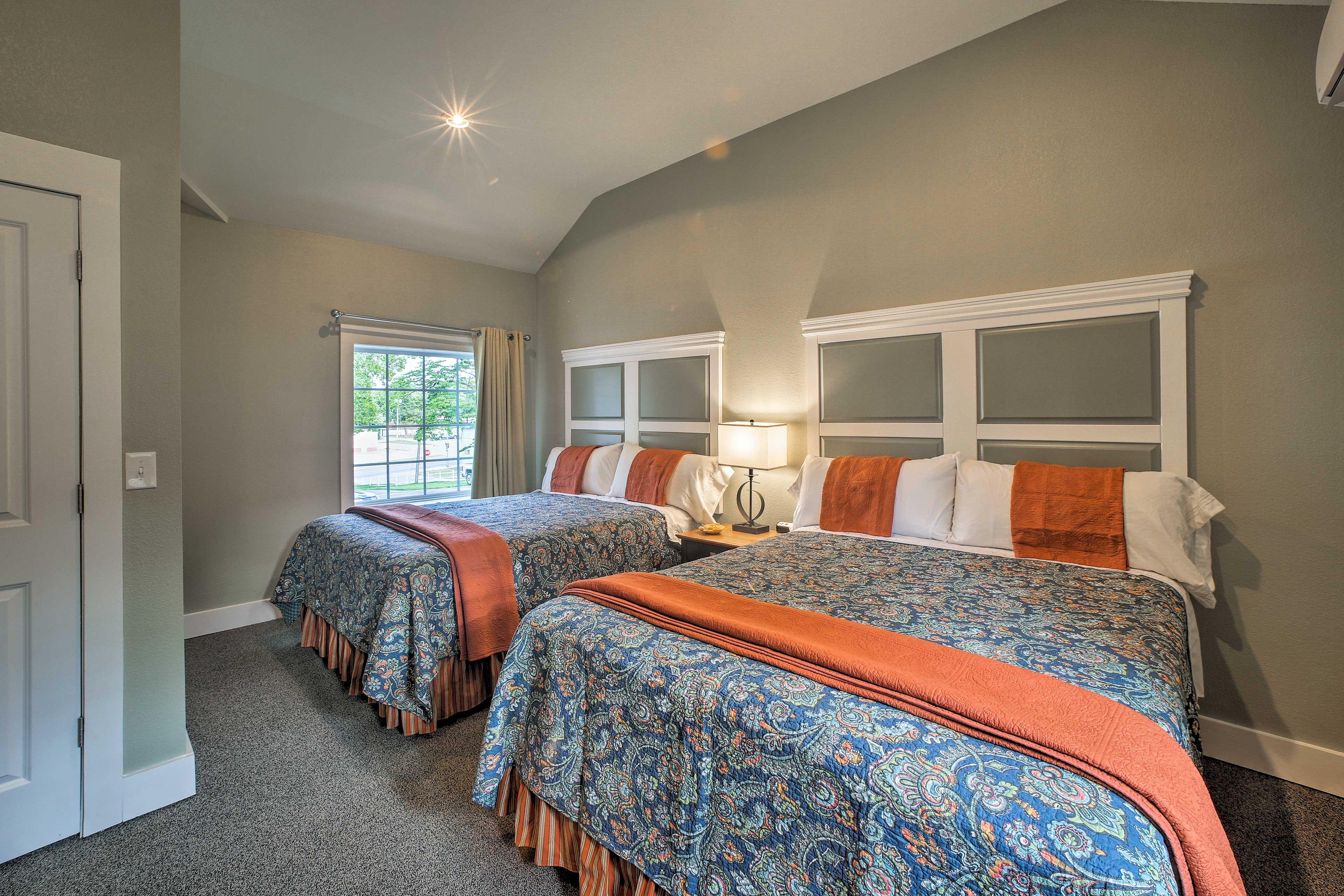 The bedroom houses 2 queen beds.