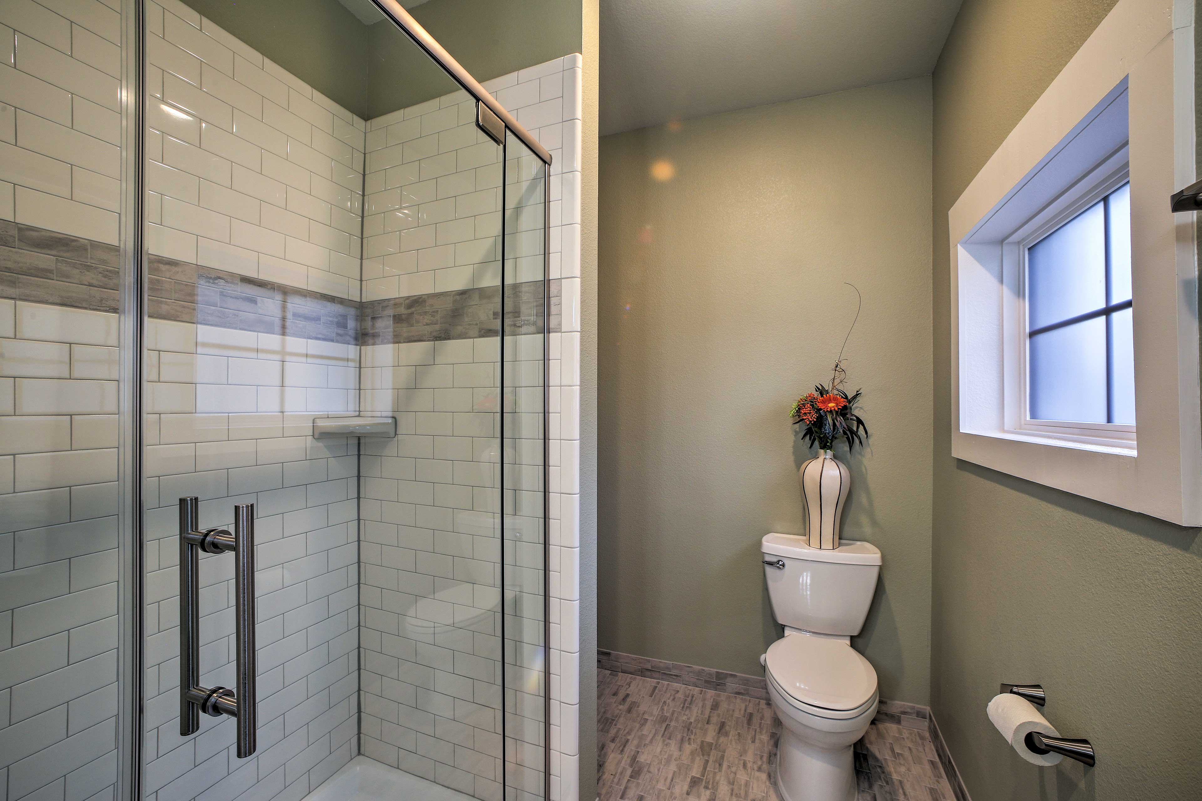 Take a cleansing rinse in the shower/tub combo.
