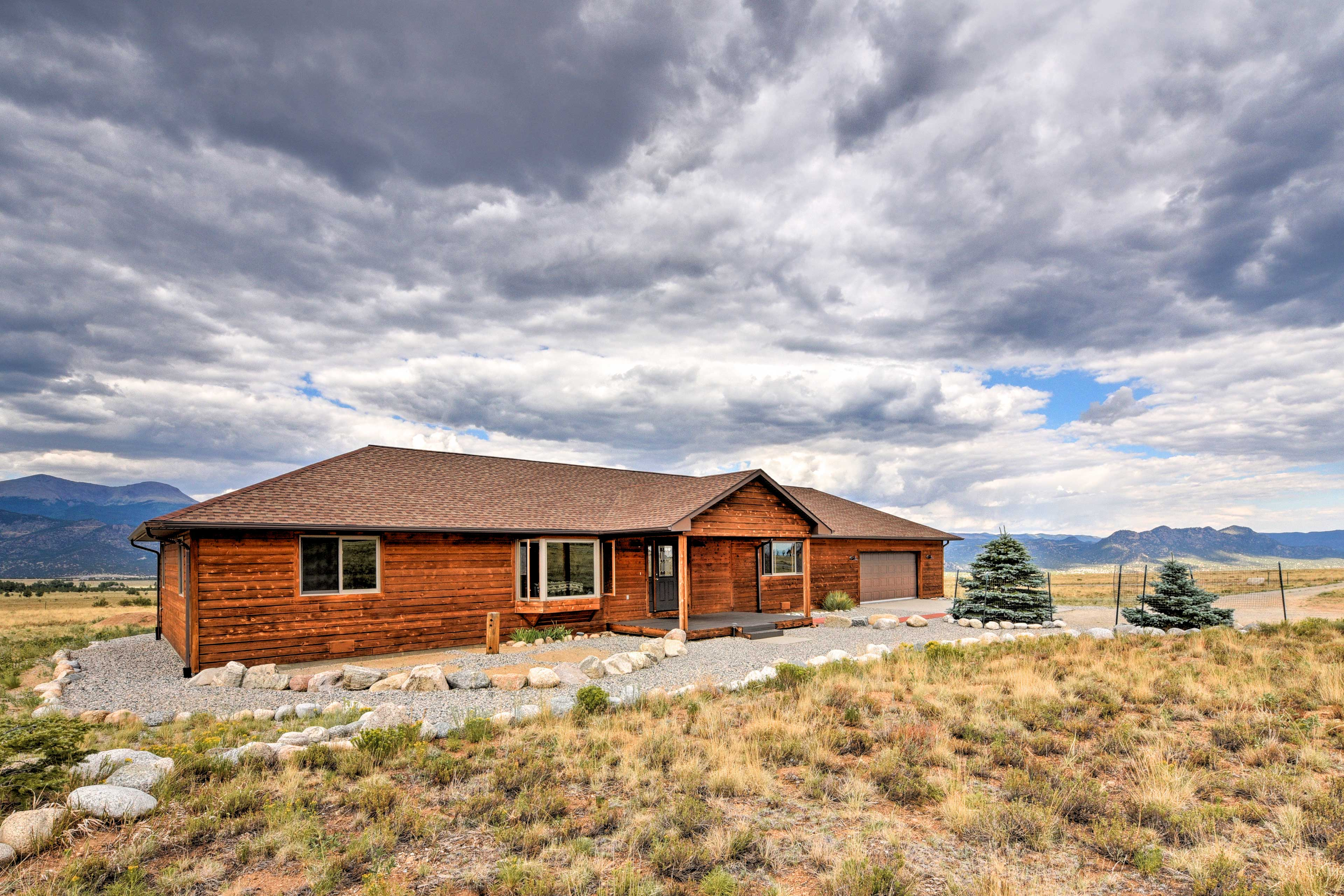 This ranch-style home sites on over 6 acres of private land.