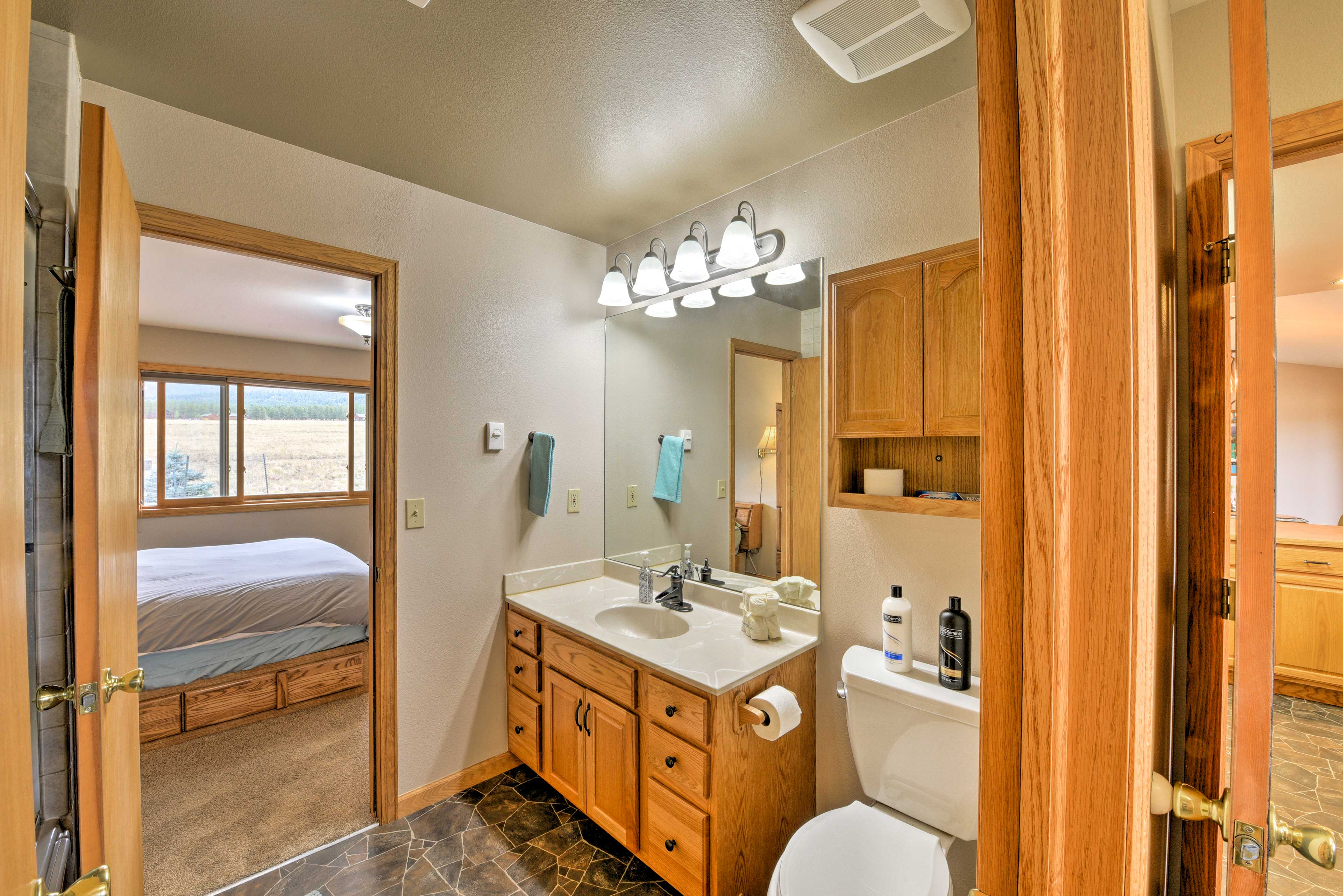 Before bed, wash up in this full en-site bathroom.