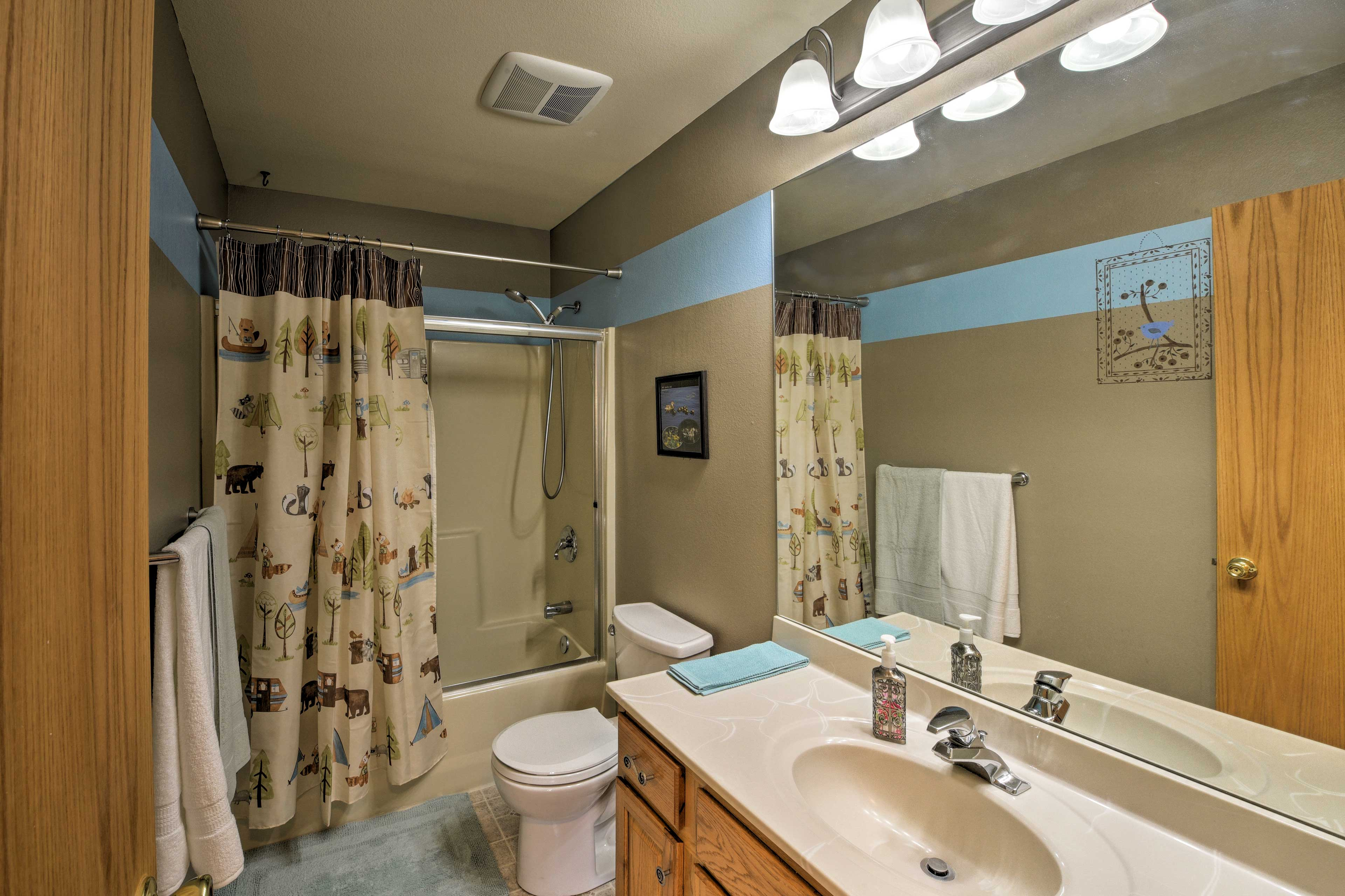This second full bathroom features a tub/shower combo.