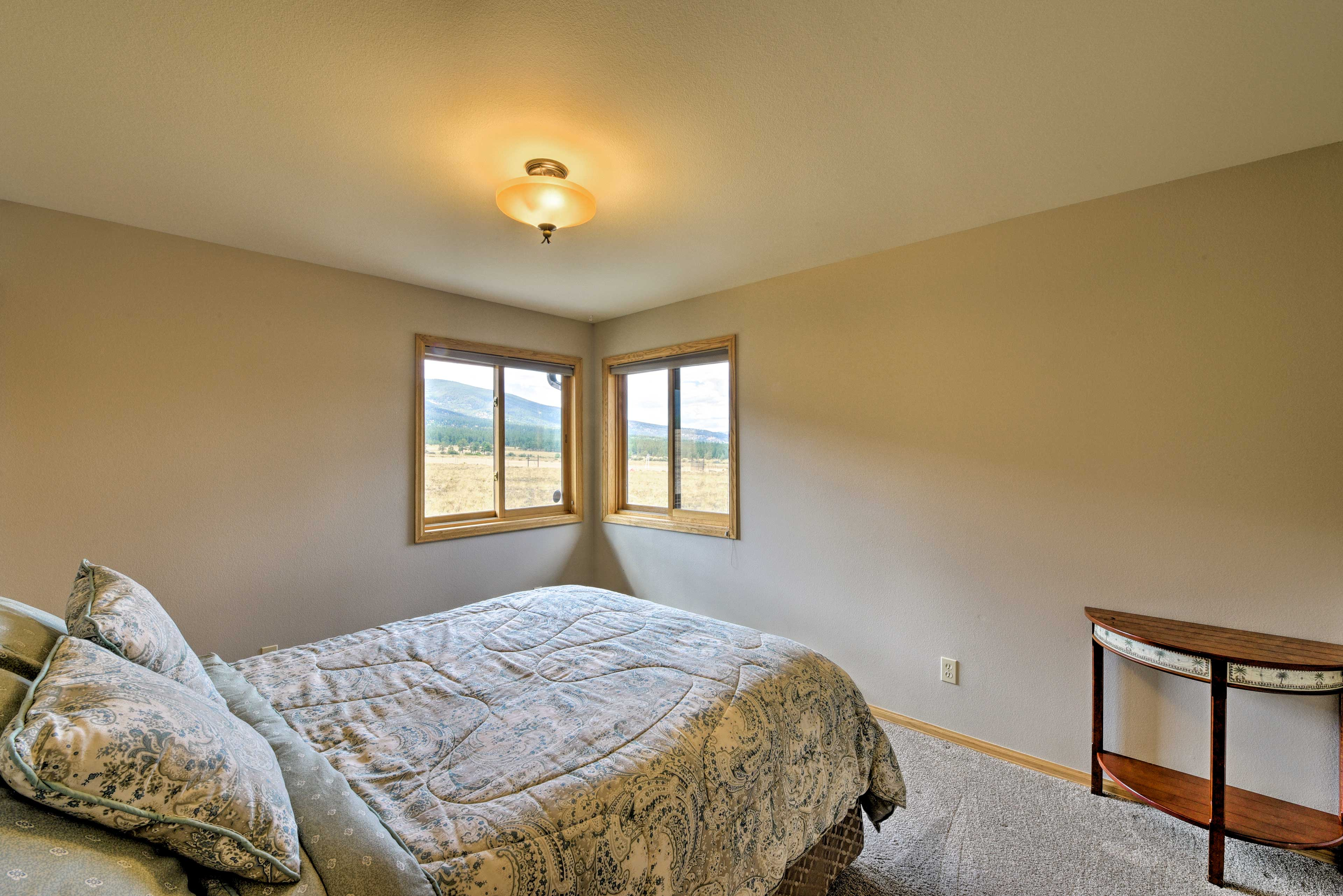 This third bedroom houses a queen-sized bed.