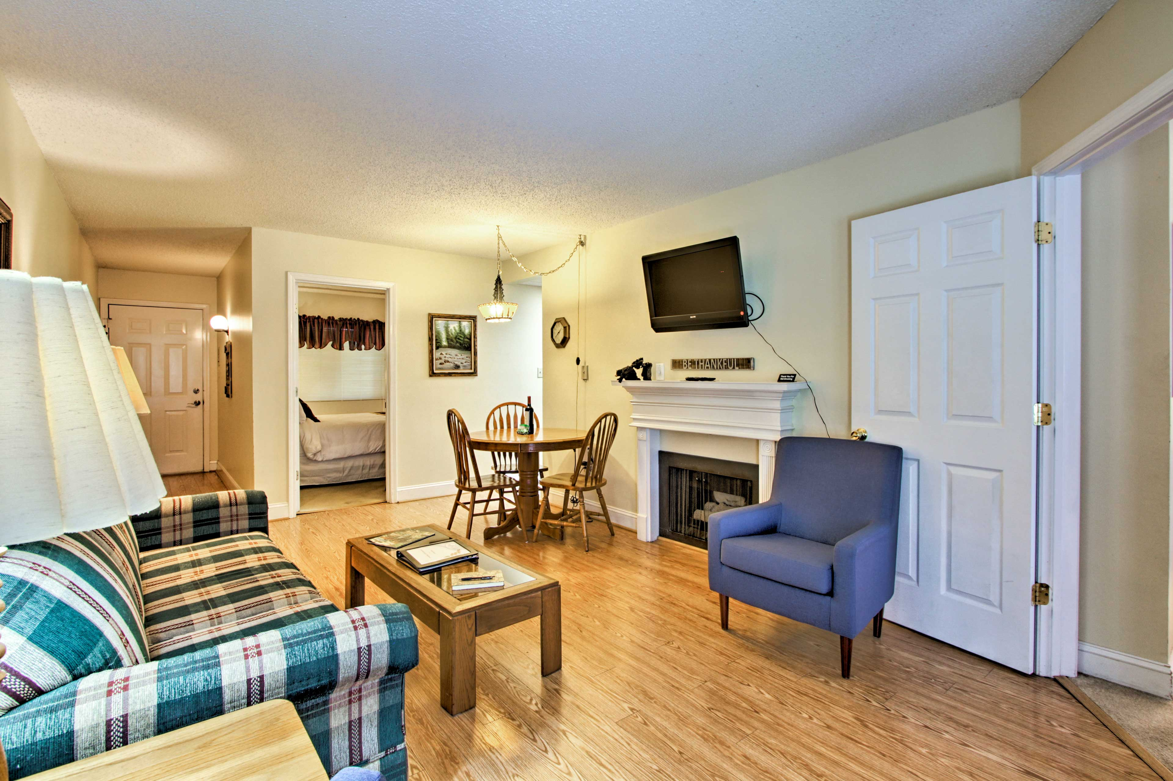 The living room features lovely hardwood floors.