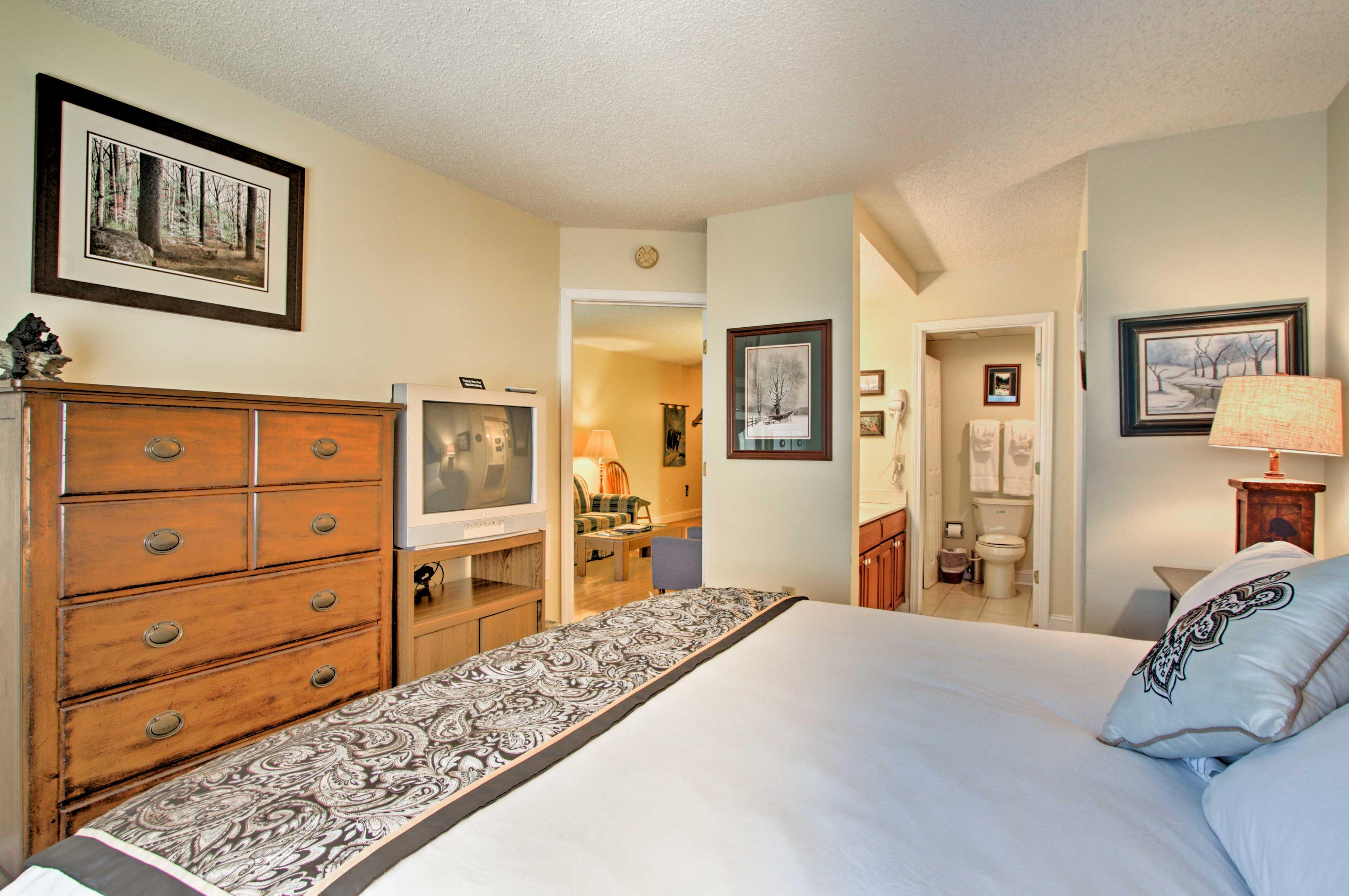 An en-suite bathroom completes the bedroom.