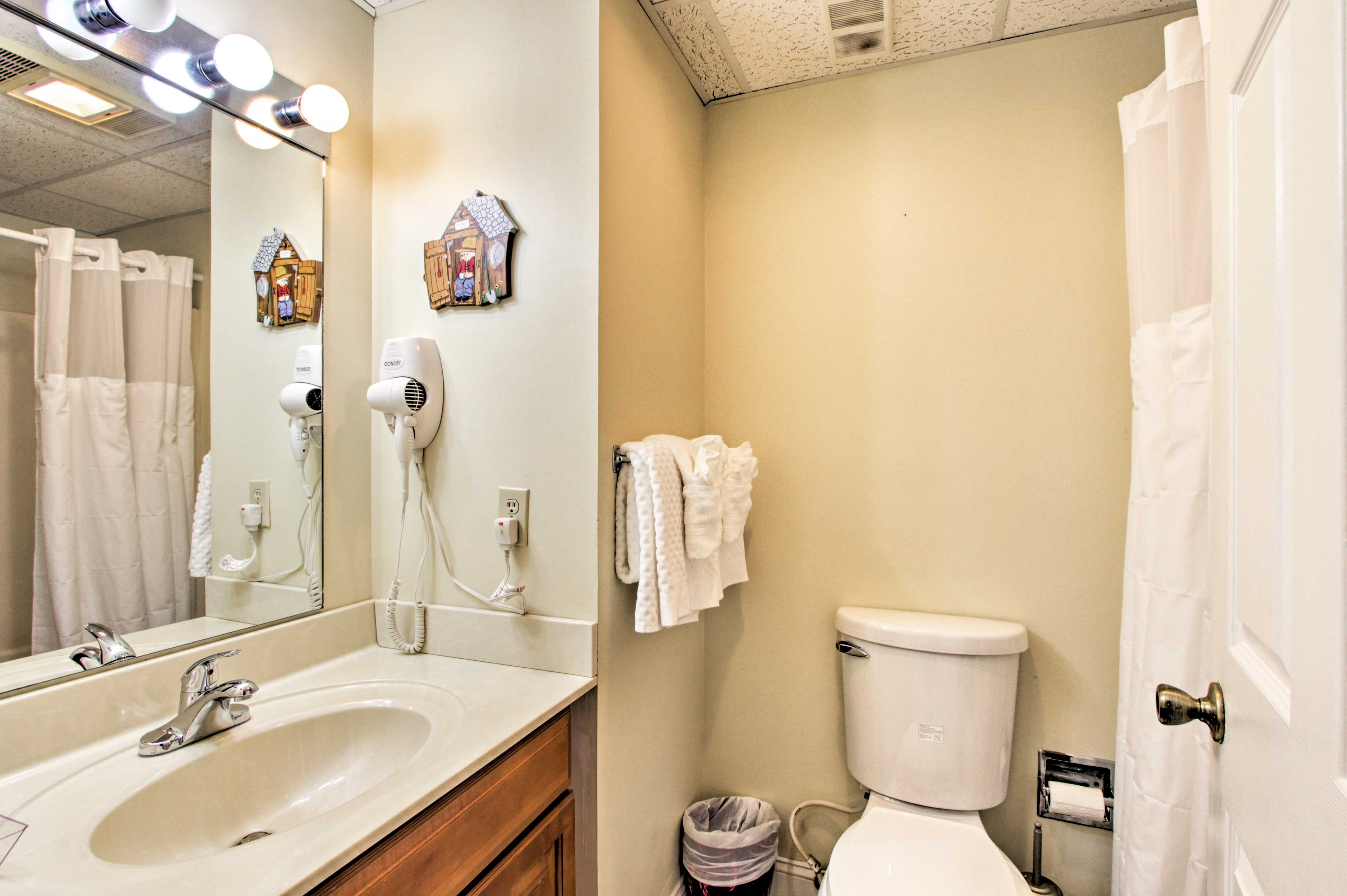 Freshen up in this clean bathroom before evening activities.