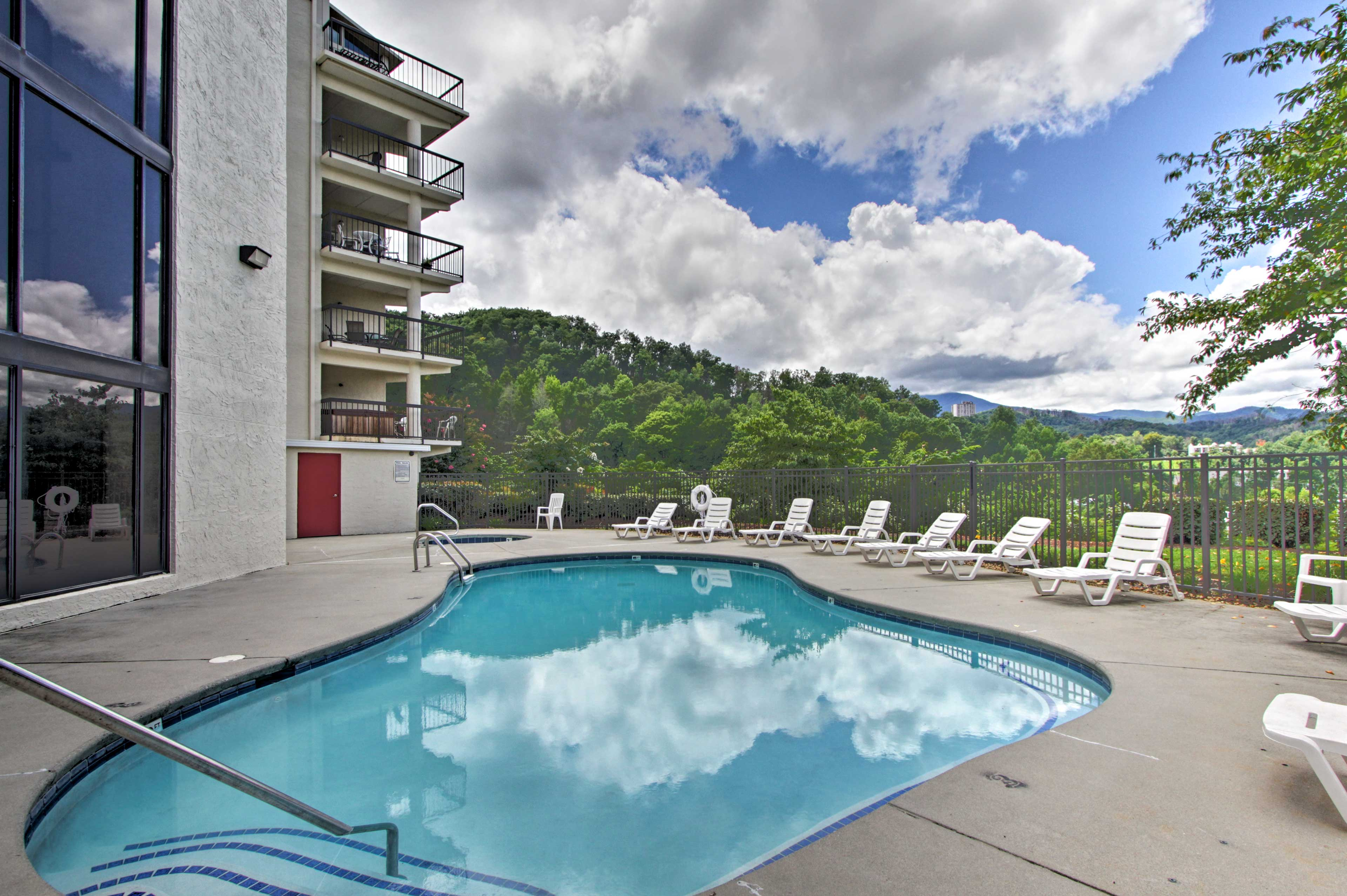 Take advantage of access to this beautiful pool facing the trees & mountains.