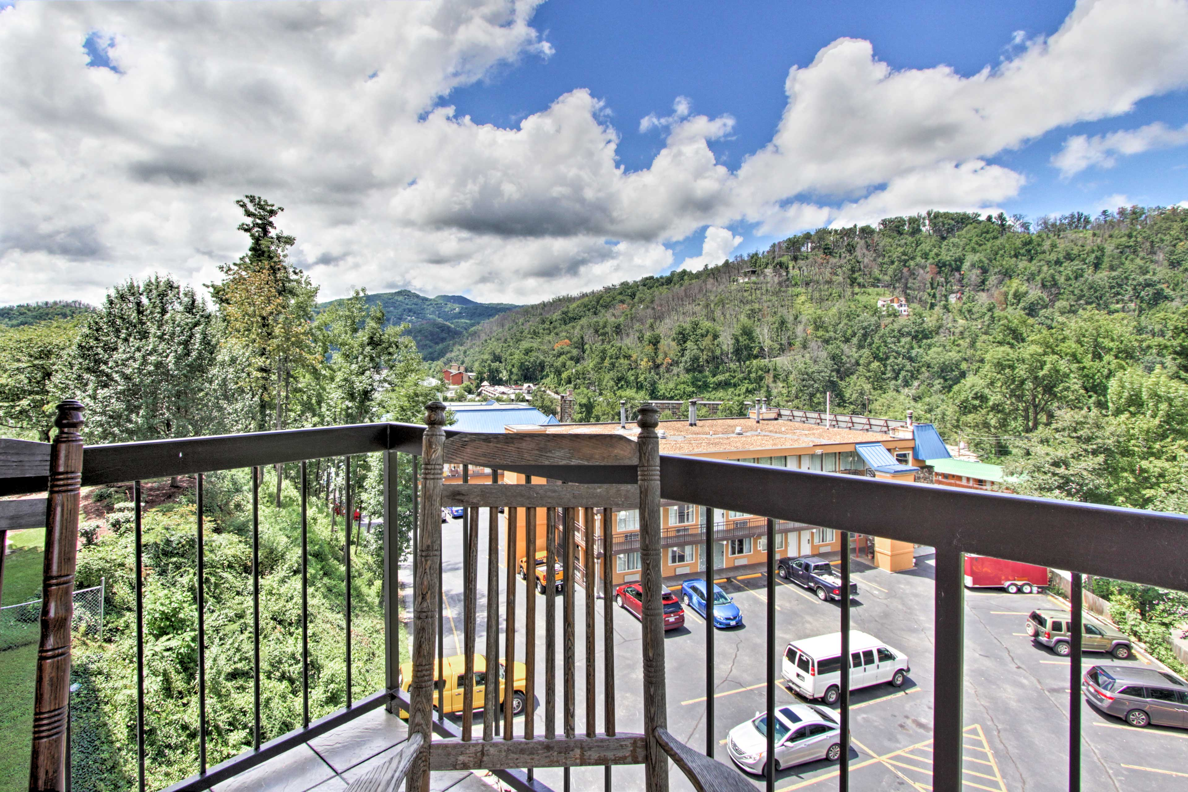 Your balcony overlooks the Smoky Mountains & faces downtown!
