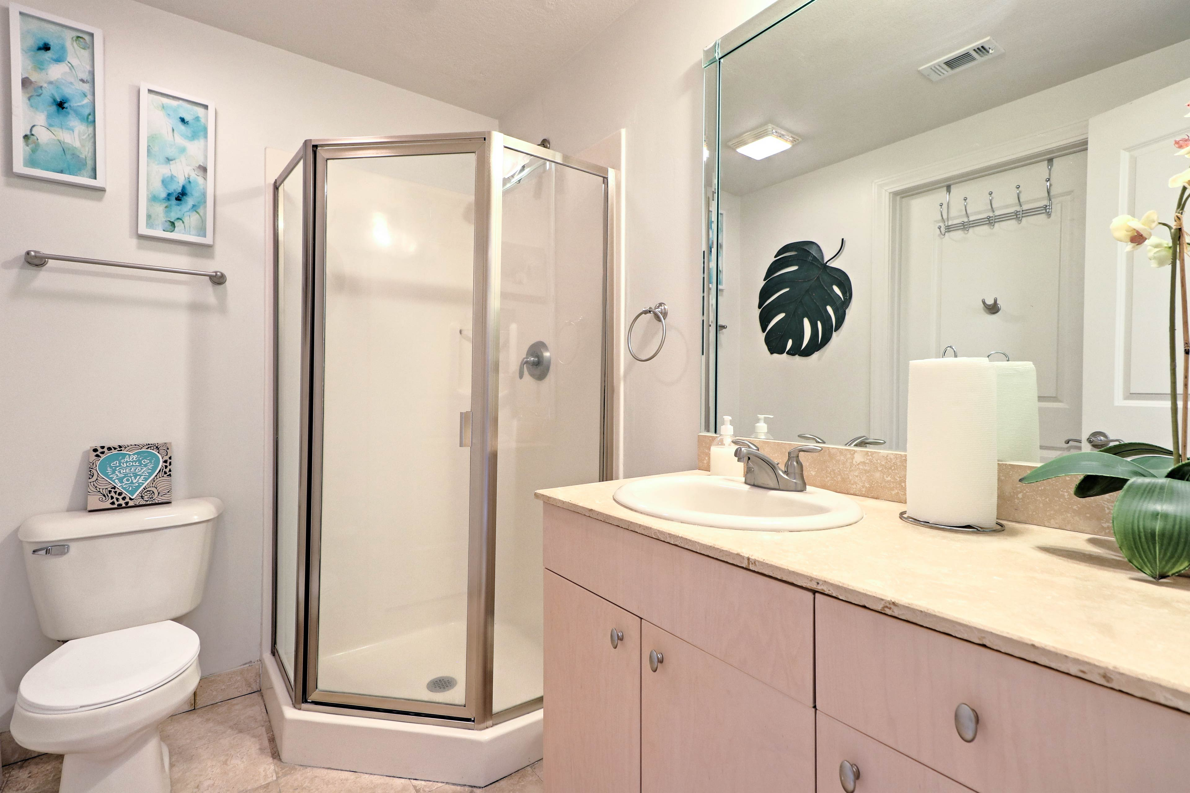 Both bathrooms are stocked with fresh towels for guests' comfort.