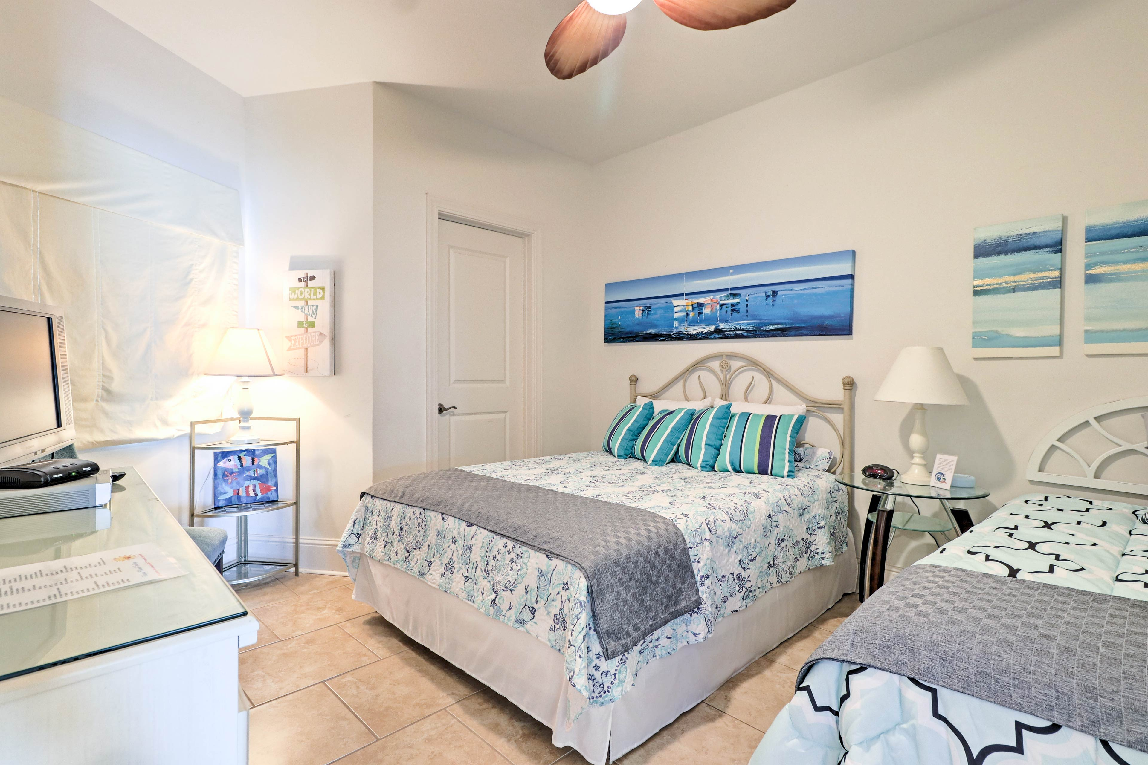 The second bedroom can sleep up to 3 guests with a queen and twin bed!