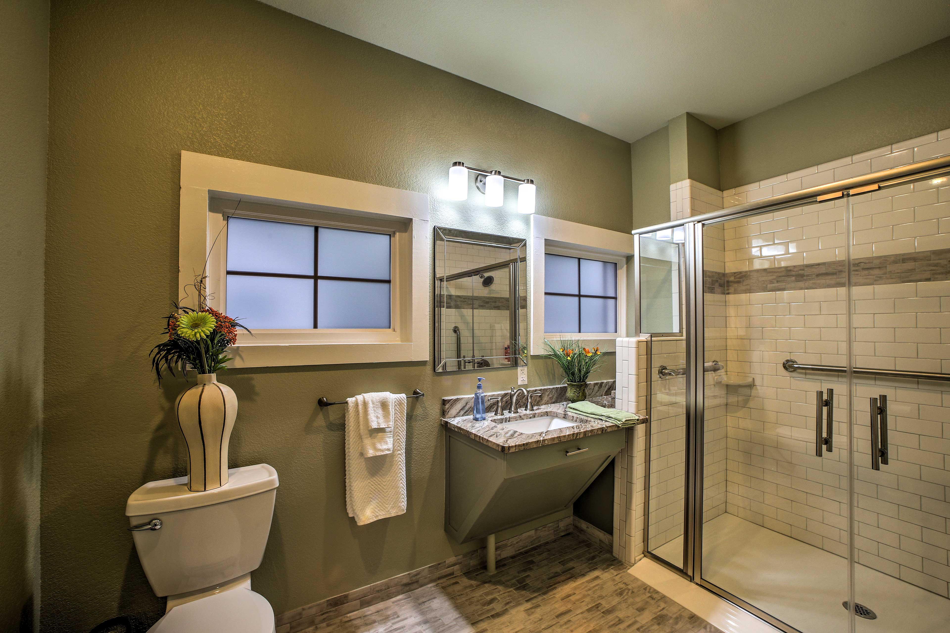 Rinse off before bed in the pristine full bathroom.