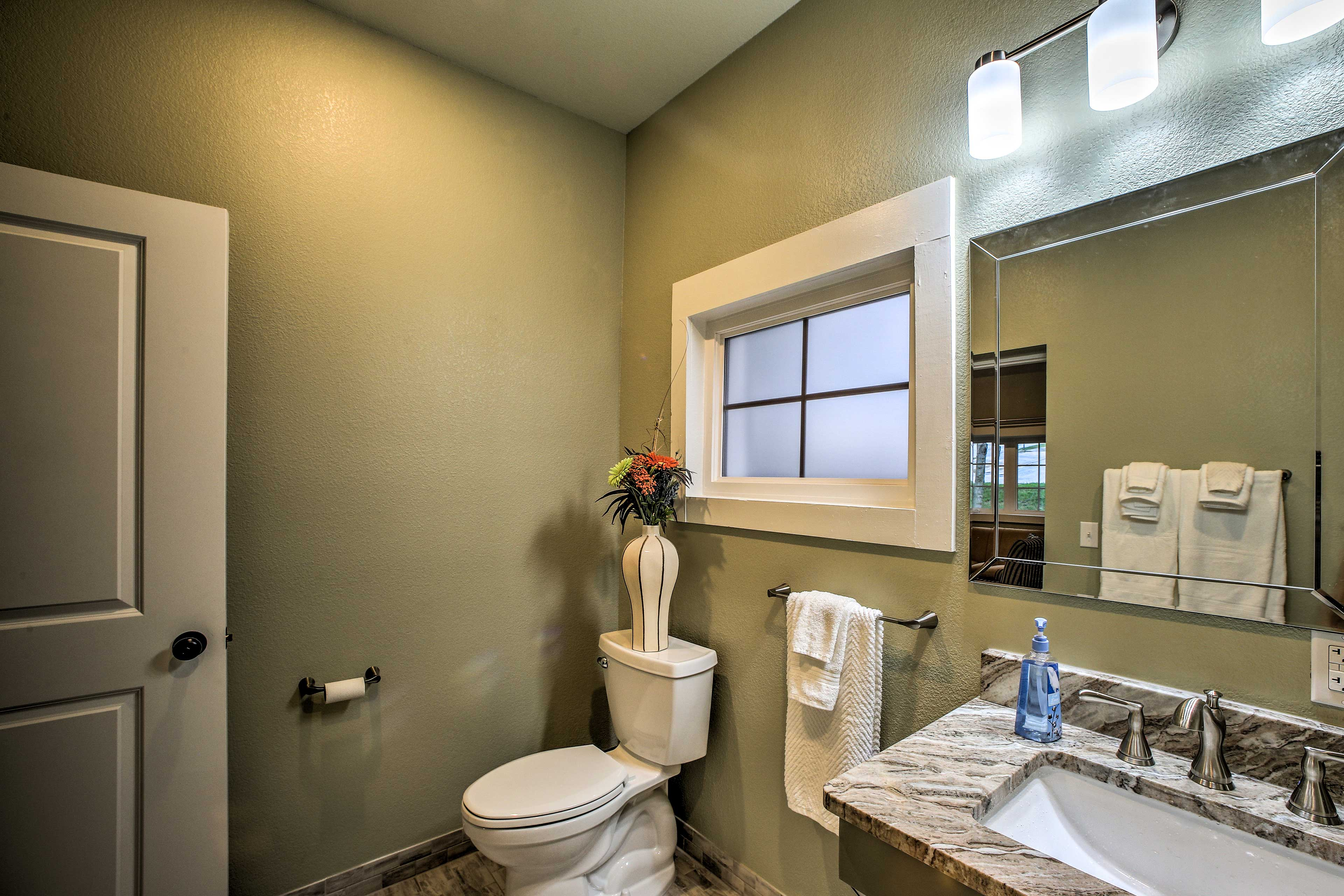 The bathroom has fresh towels waiting!