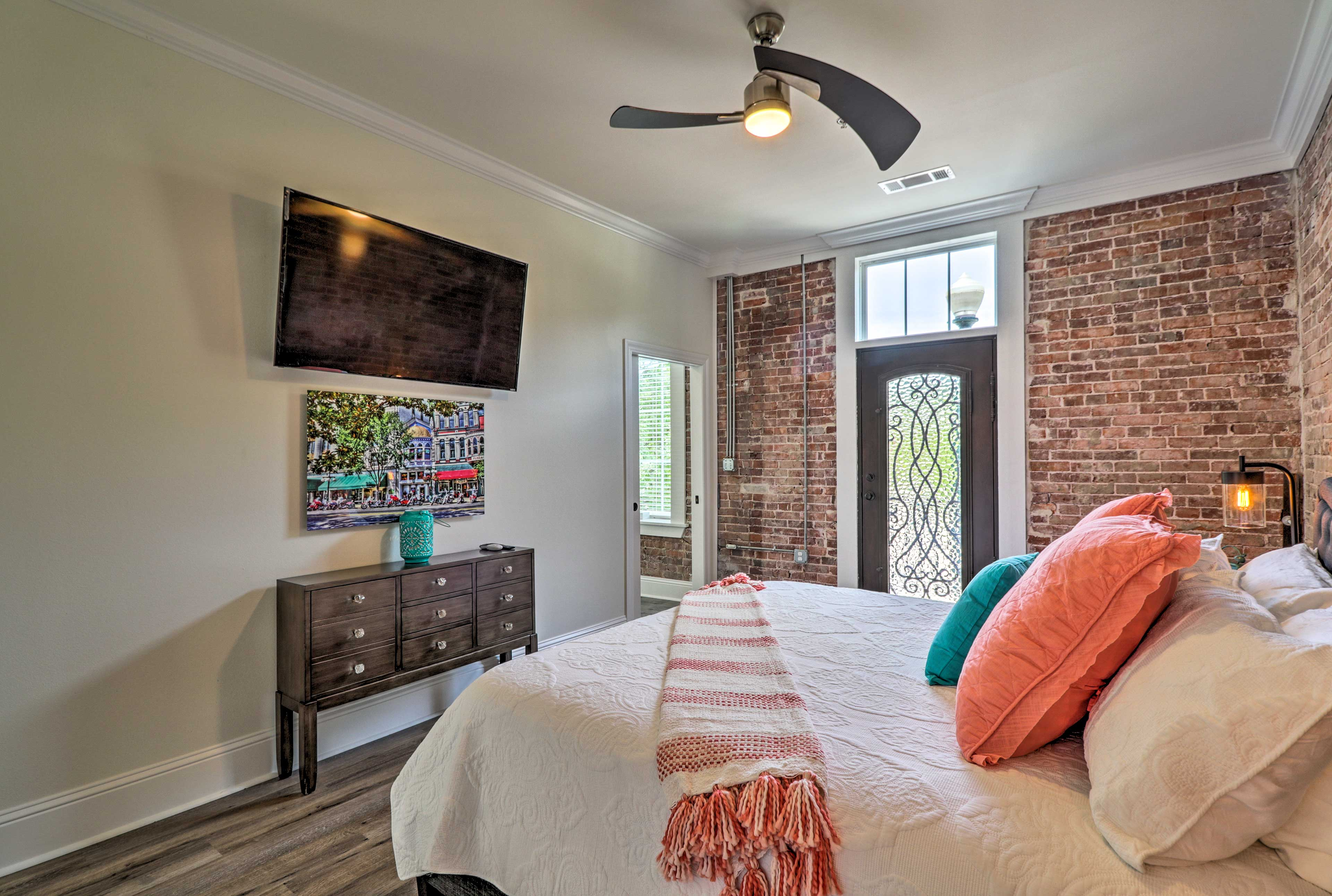 The master bedroom is connected to a second private balcony.