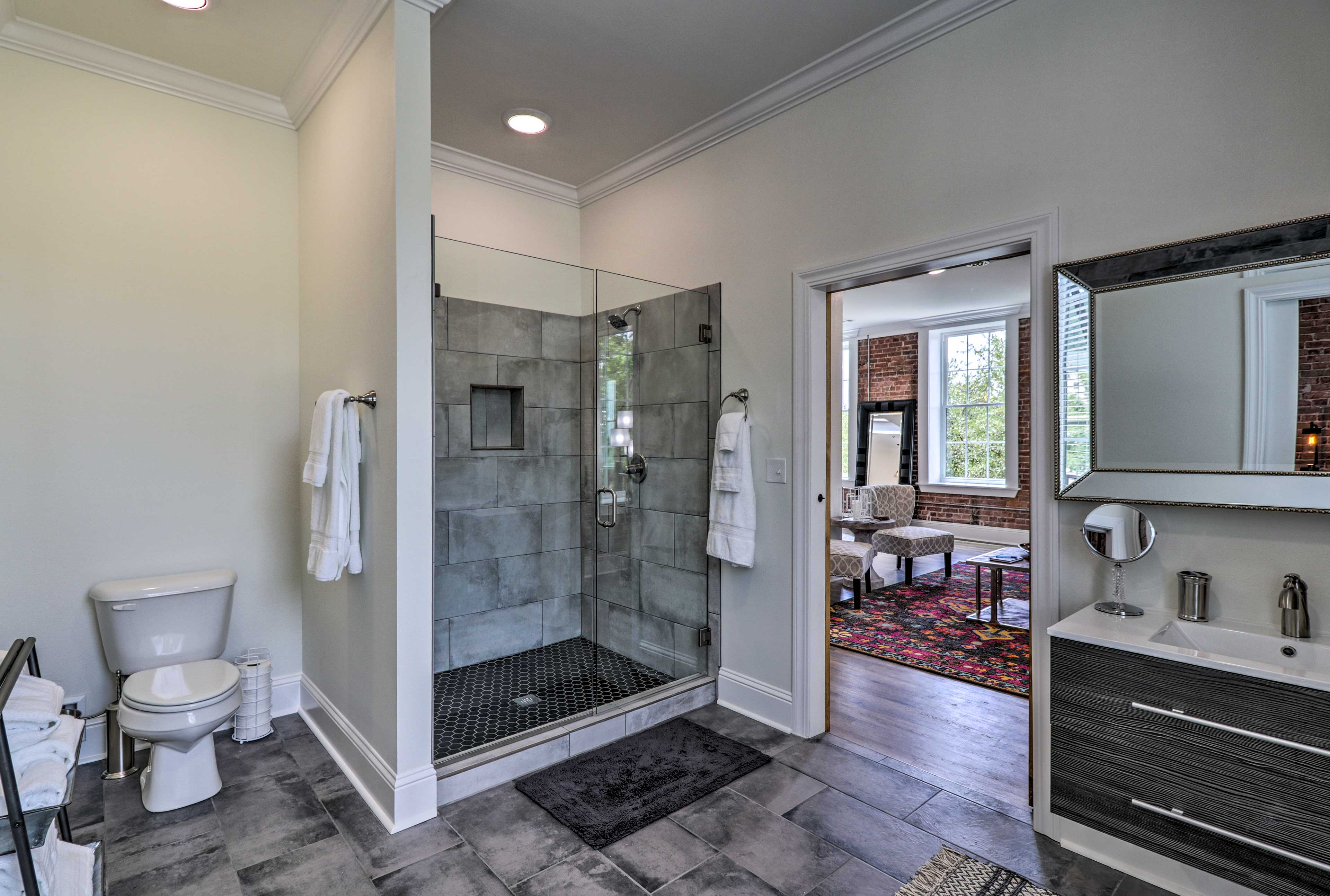 Freshen up in this spacious walk-in shower.