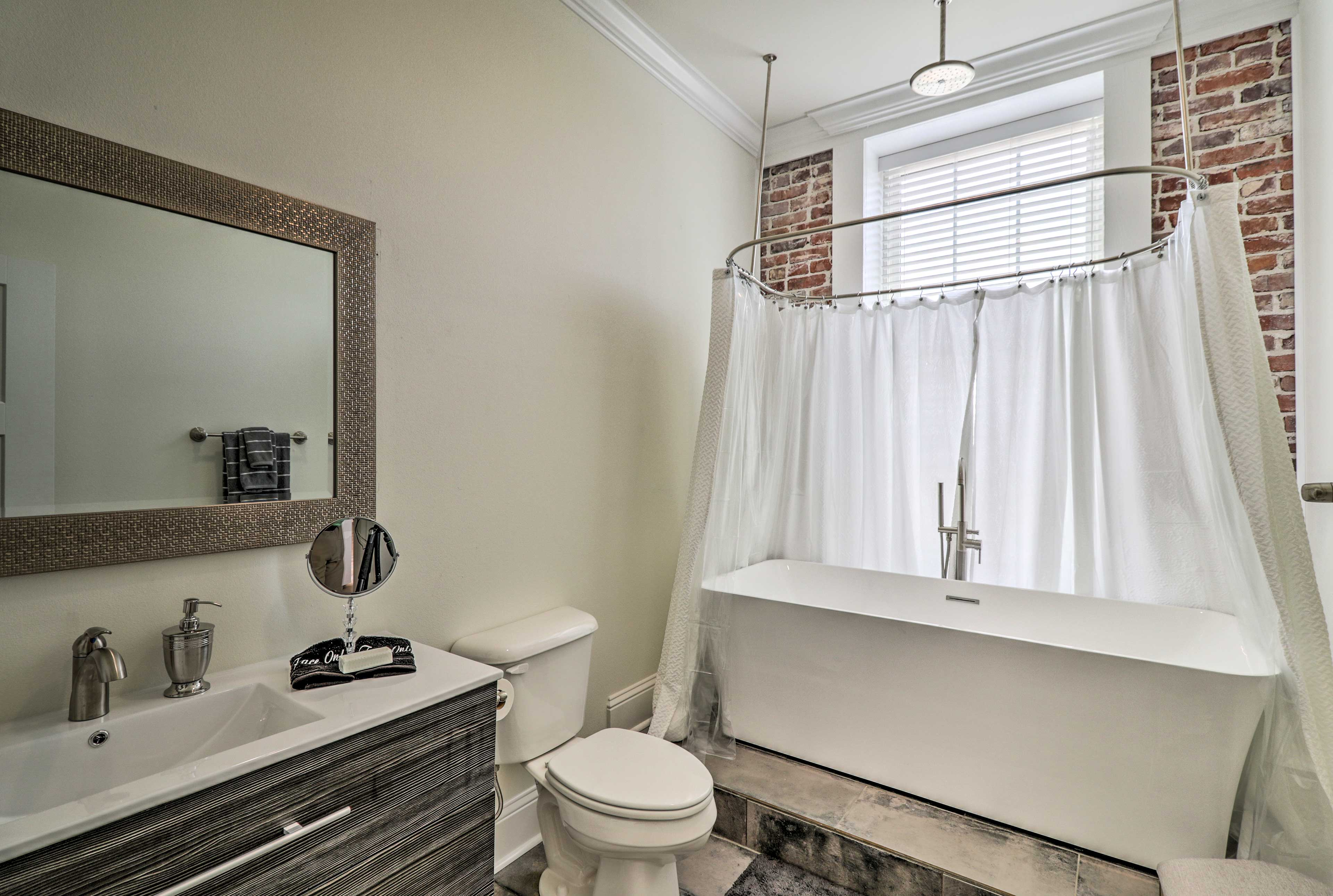This full en-suite bathroom includes a tub/shower combo.