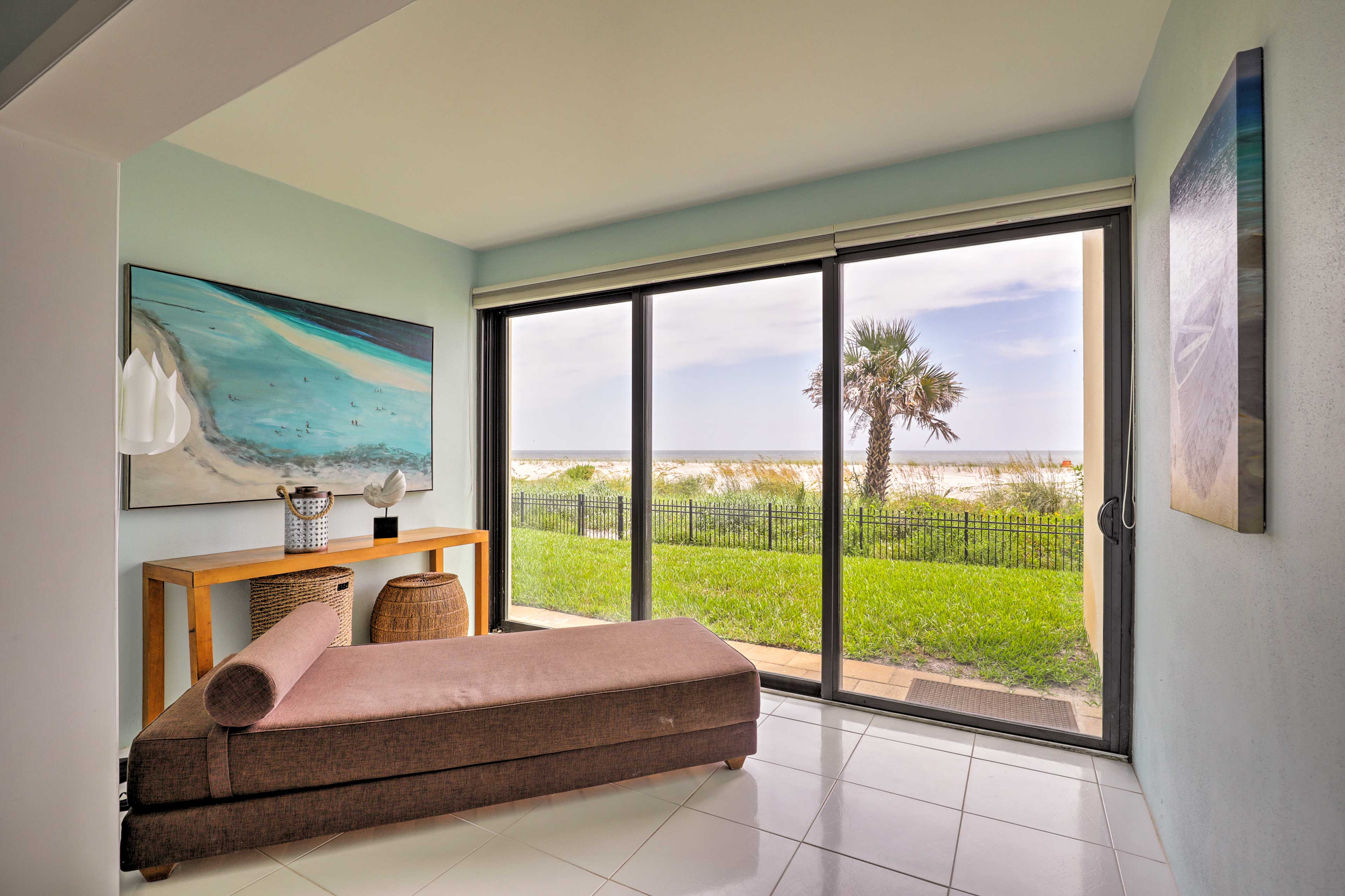 Explore the shore from this oceanfront Jacksonville Beach vacation rental condo.