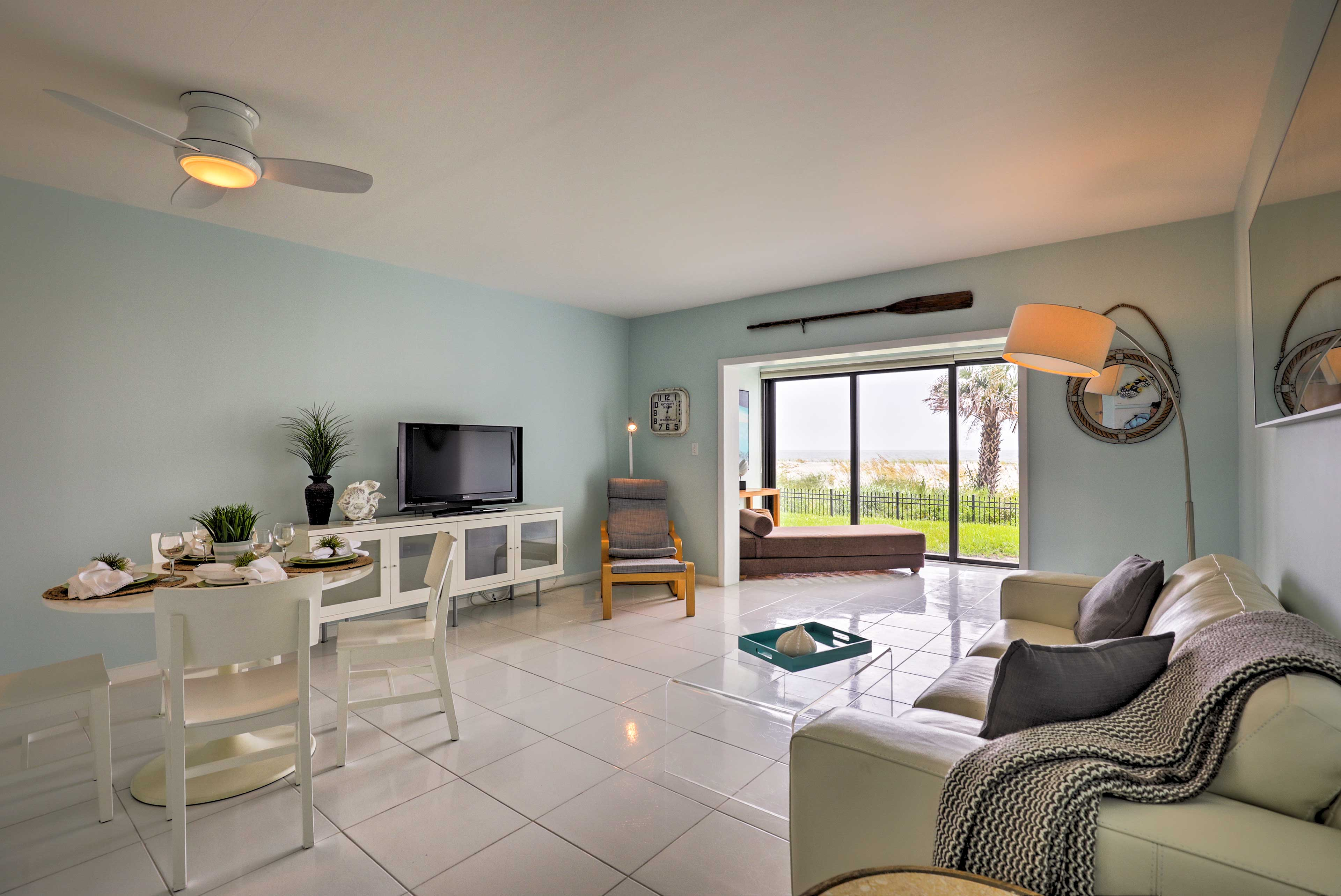 Sweeping ocean views are visible throughout the interior.