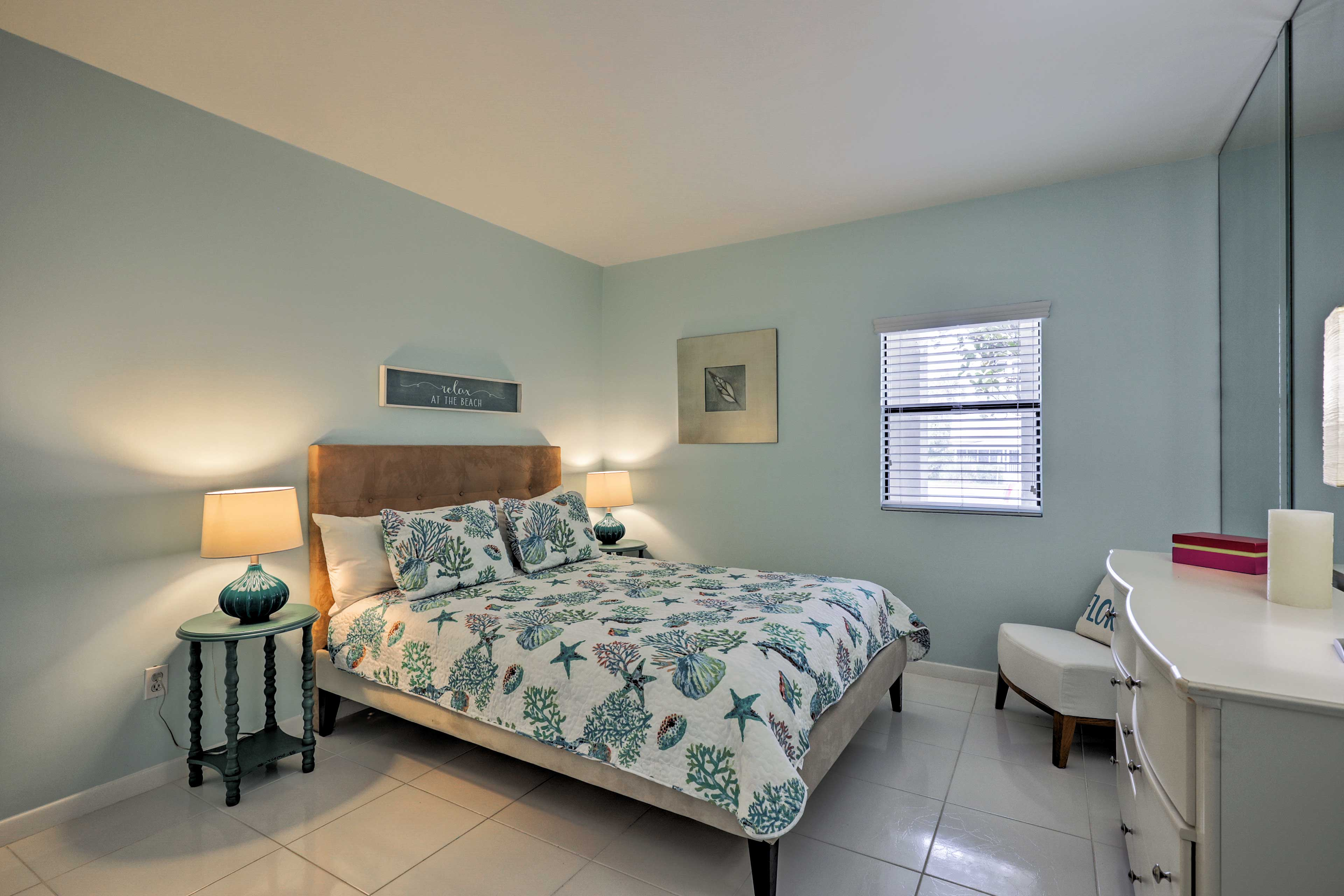 The bedroom hosts a plush queen bed.