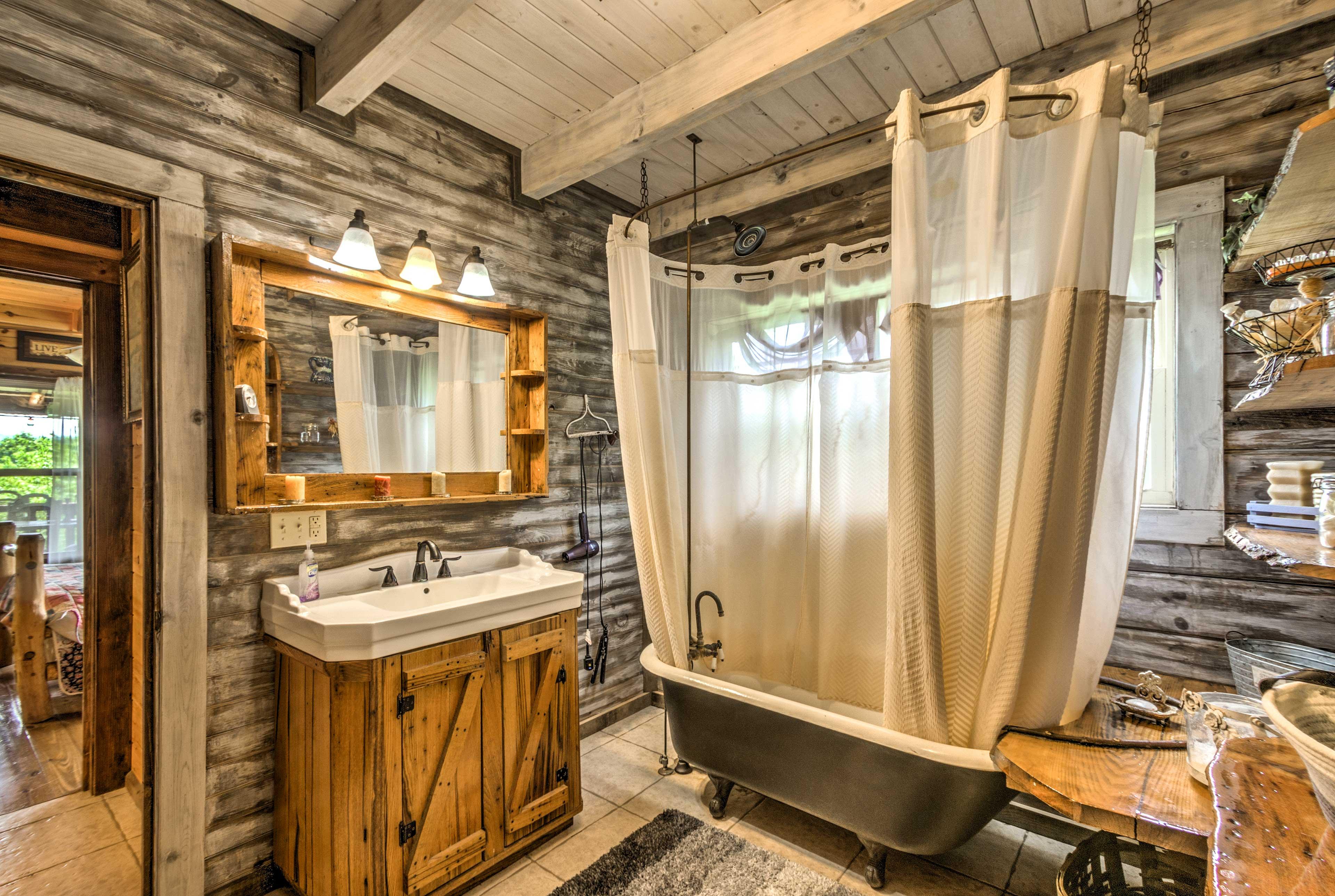 The en-suite bathroom offers a shower/tub combo.