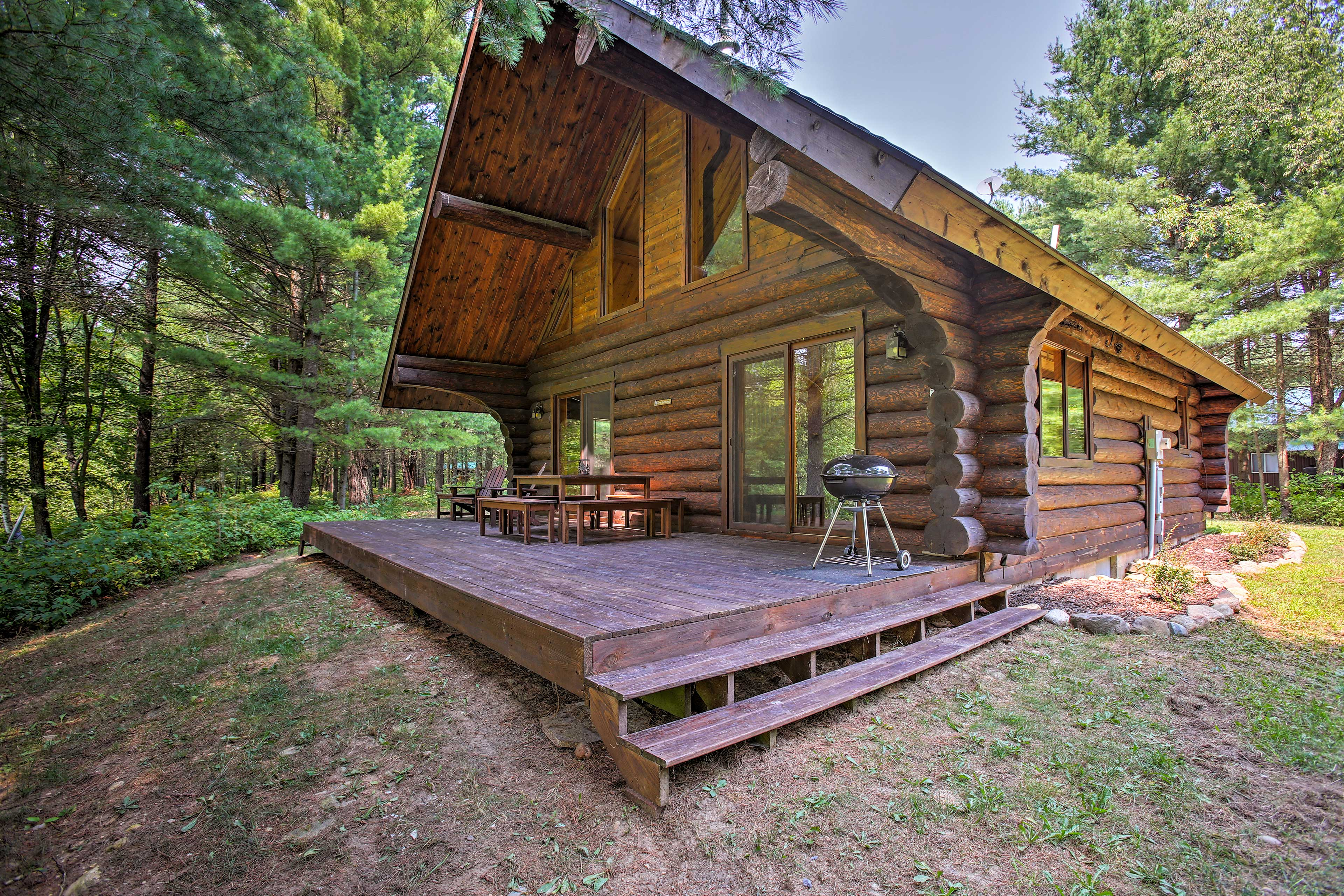 Experience the tranquility & adventures of nature at this secluded log cabin.