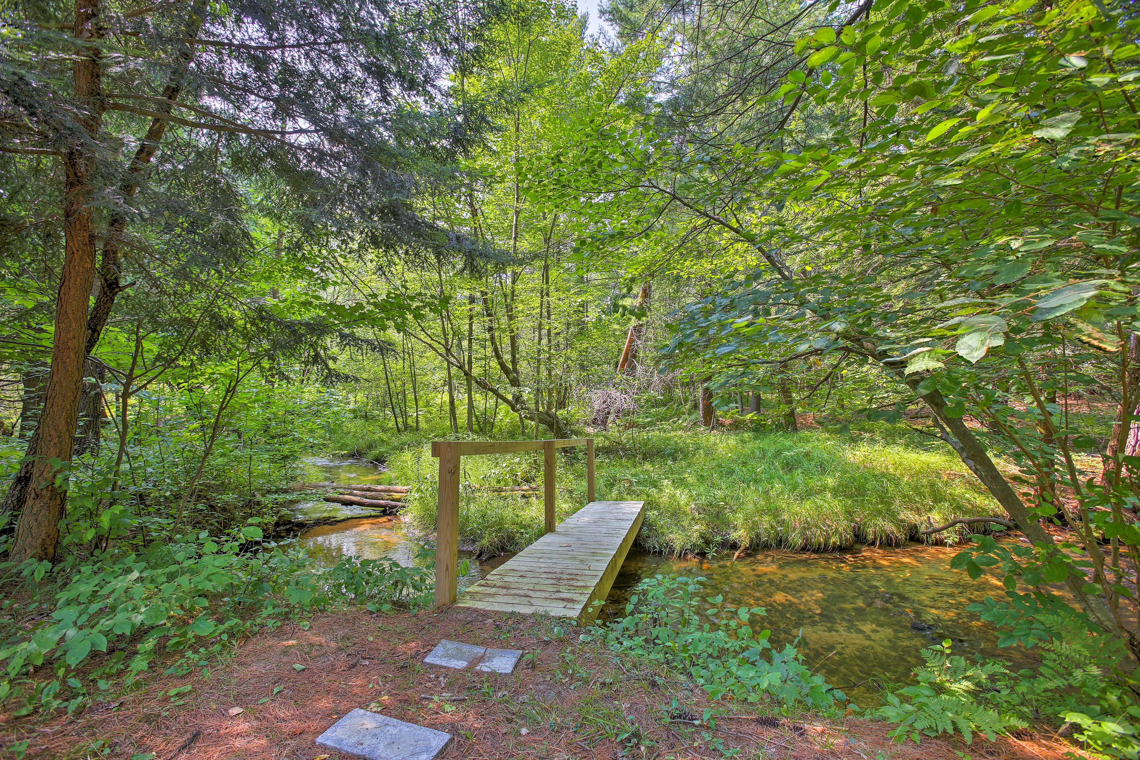 The property includes several miles of trails showcasing northwest MI landscape.