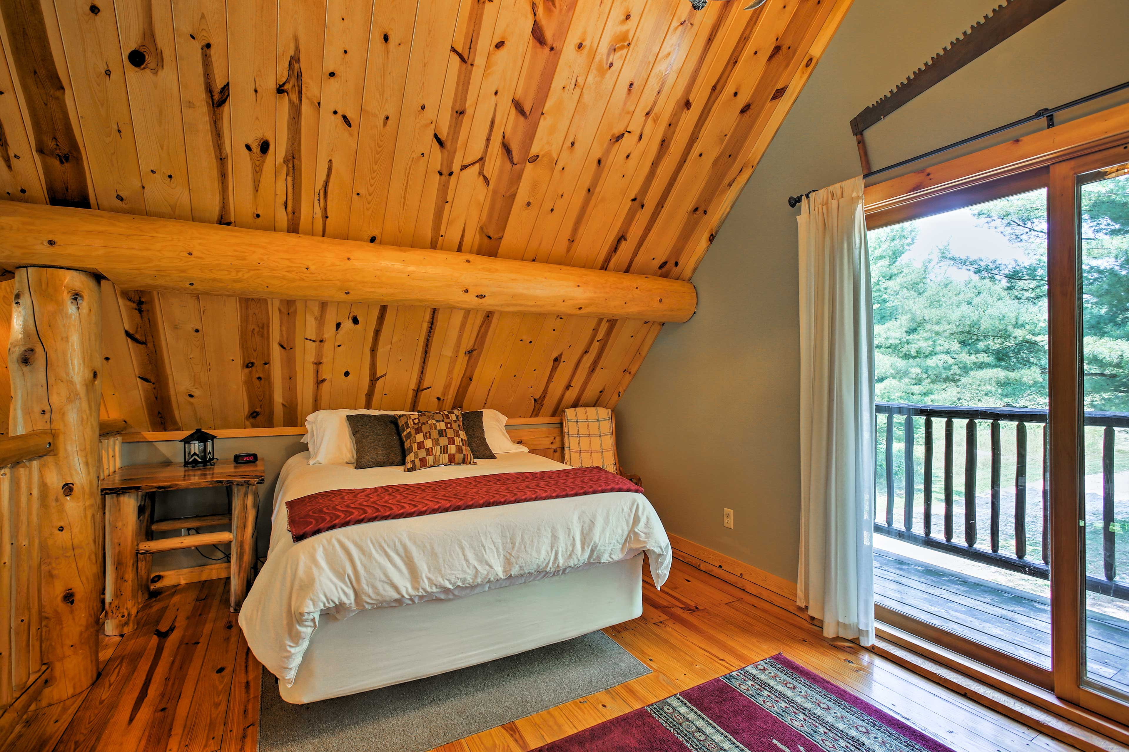 Sleep cozily in this lovely queen-sized bed in the master loft.
