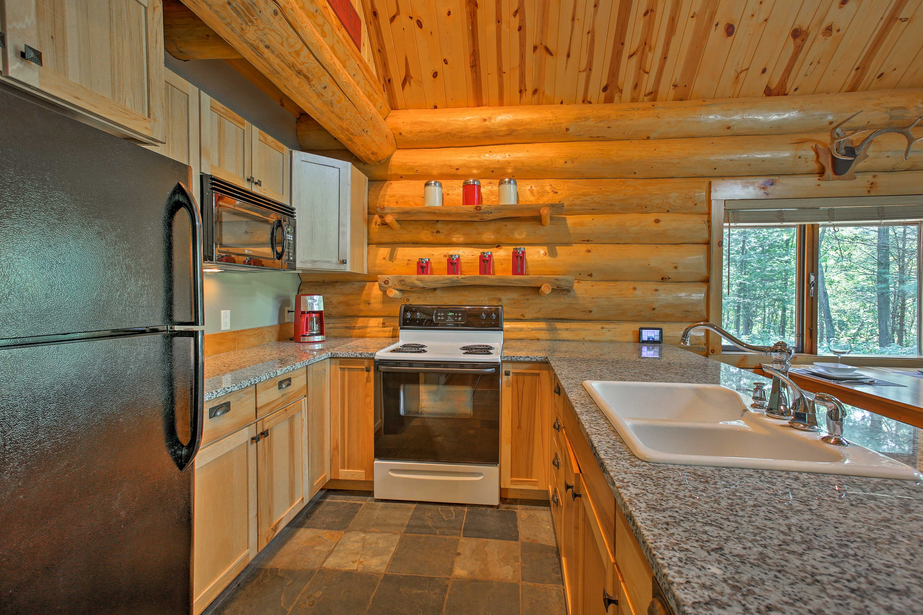 Prepare a delicious meal to enjoy on the deck in this fully equipped kitchen!