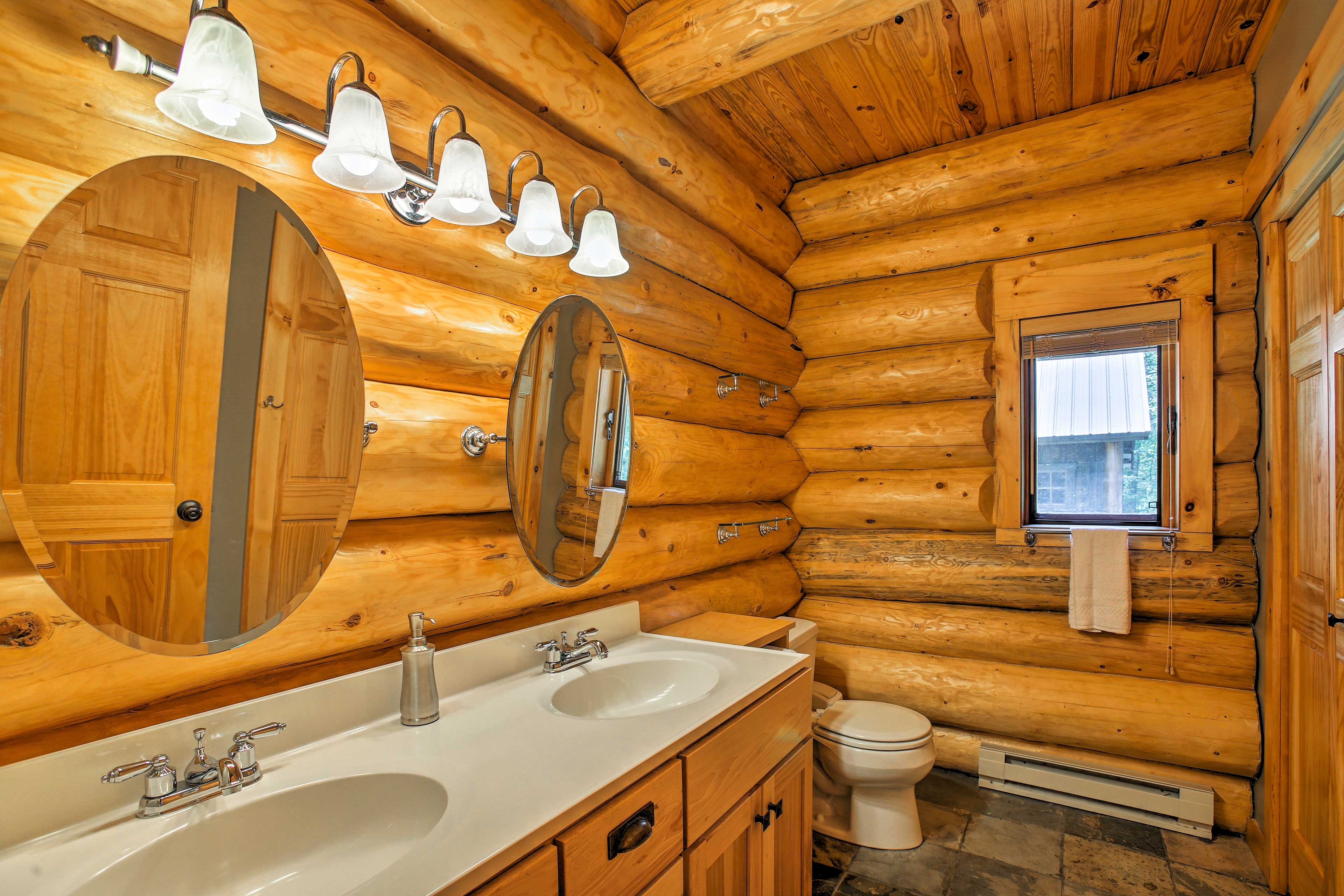 The spacious bathroom offers a shower to rinse off.