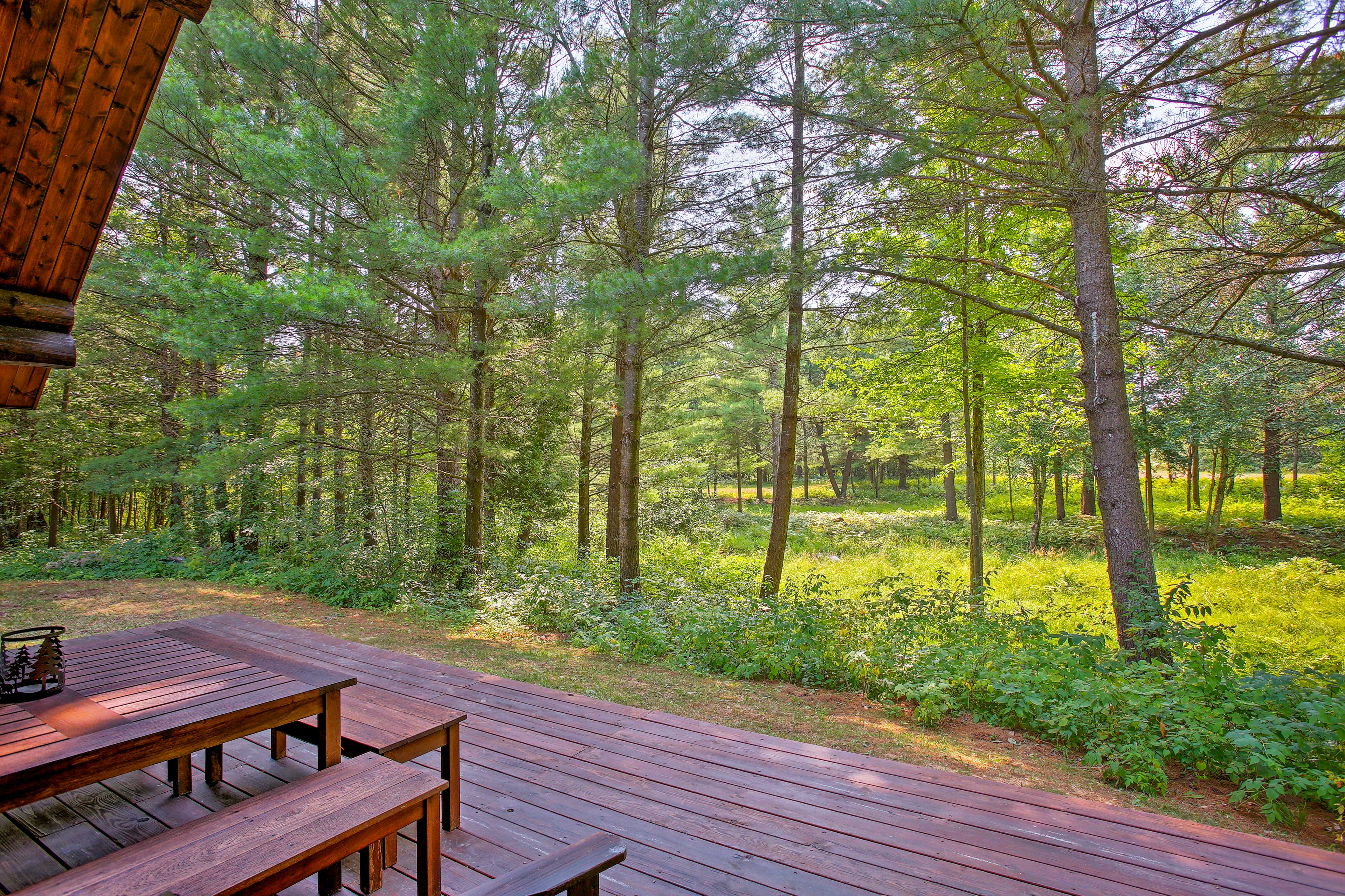 The deck opens right up to the expansive yard & surrounding property.