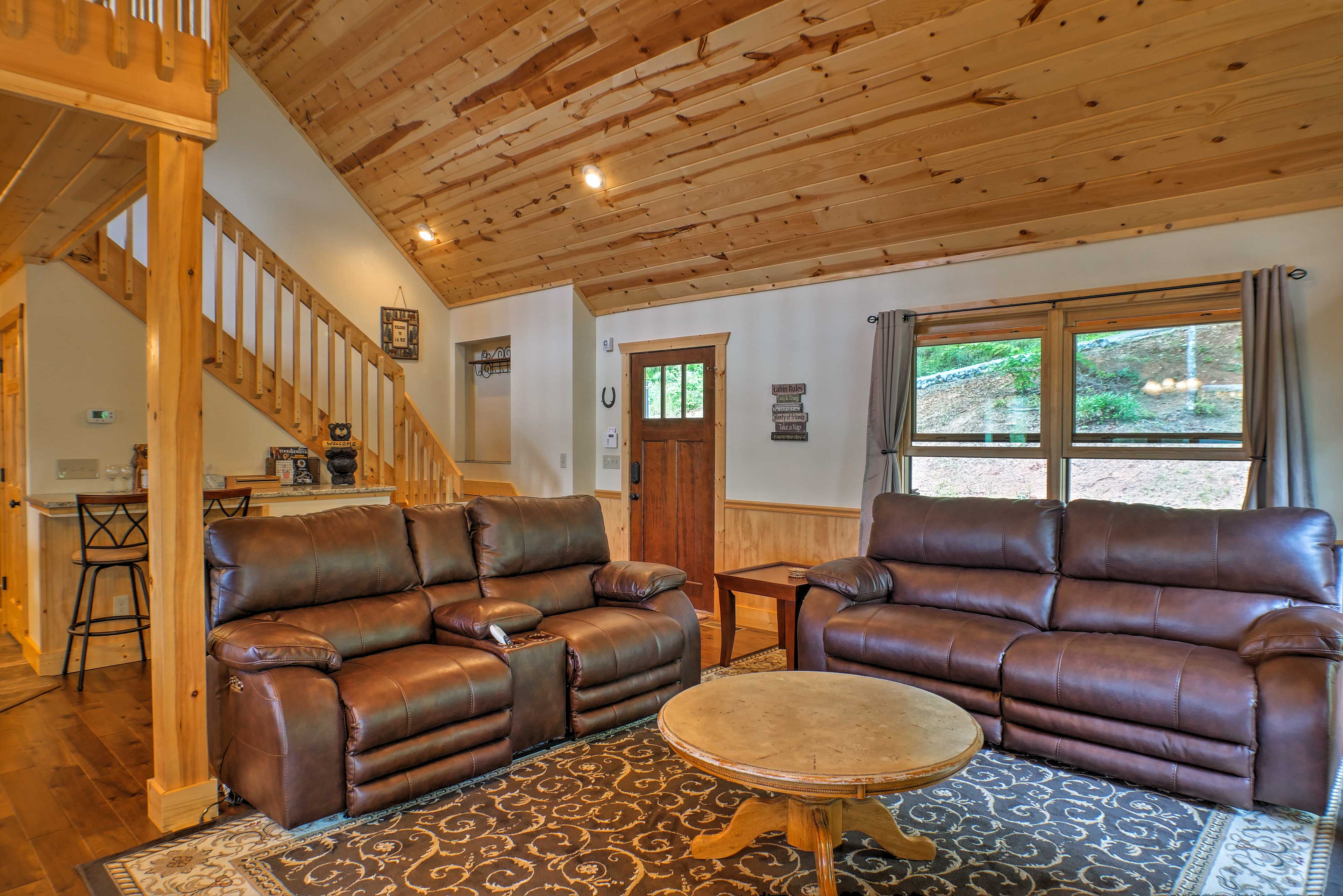 Hardwood floors and ceilings create the authentic cabin ambiance.