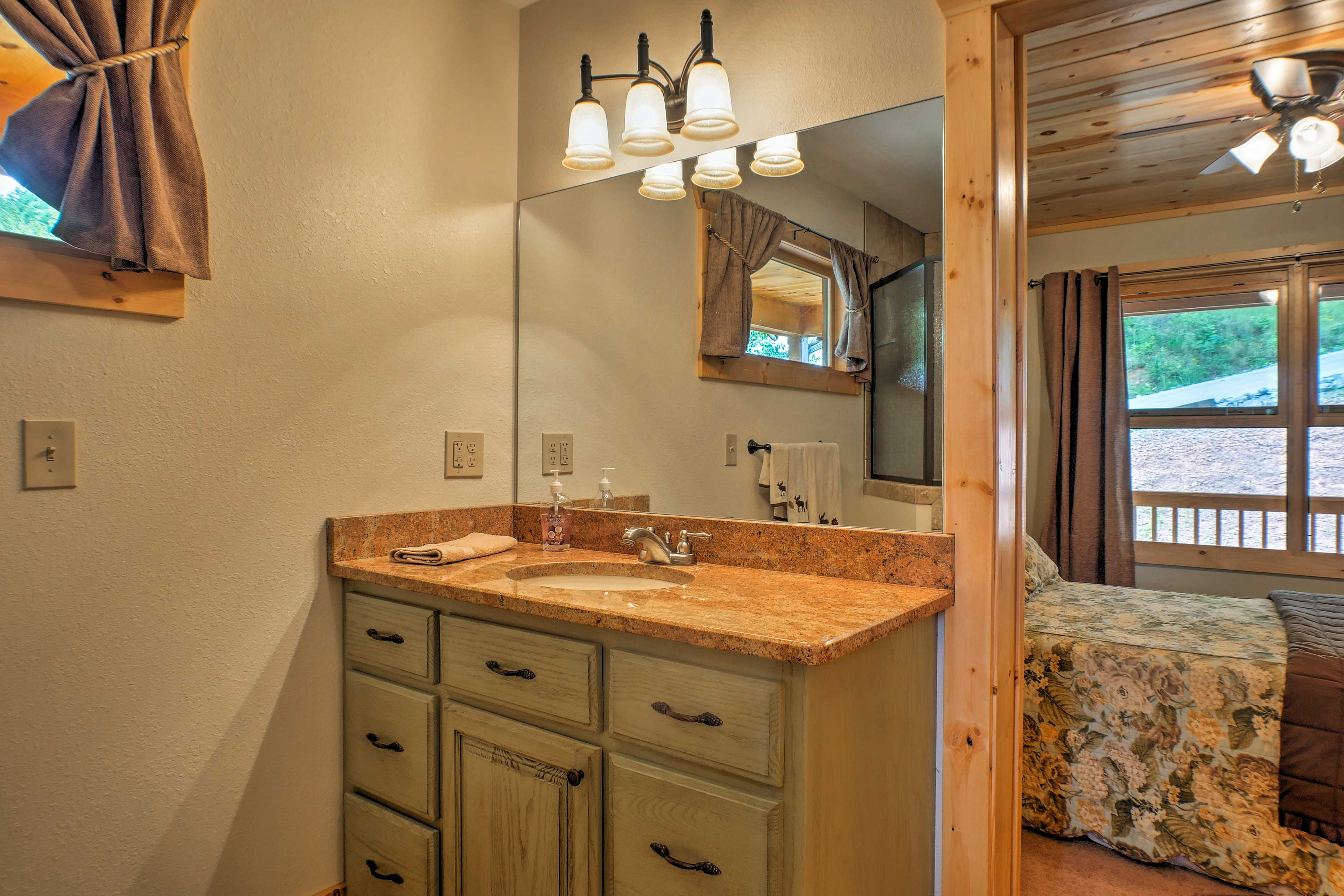 Get ready each day at the mirrored vanity.