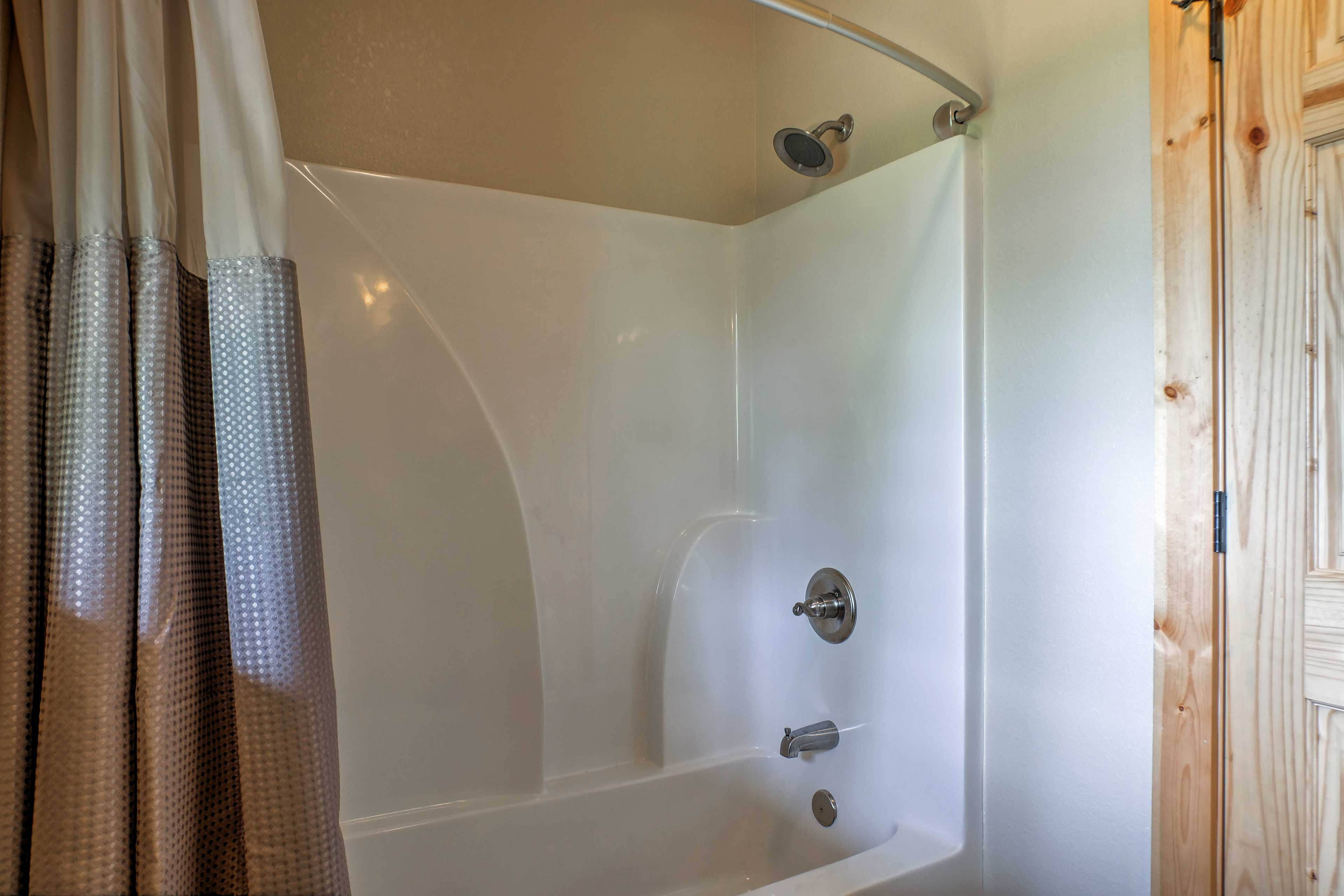 Take a relaxing rinse in the shower/tub combo of the third bathroom.