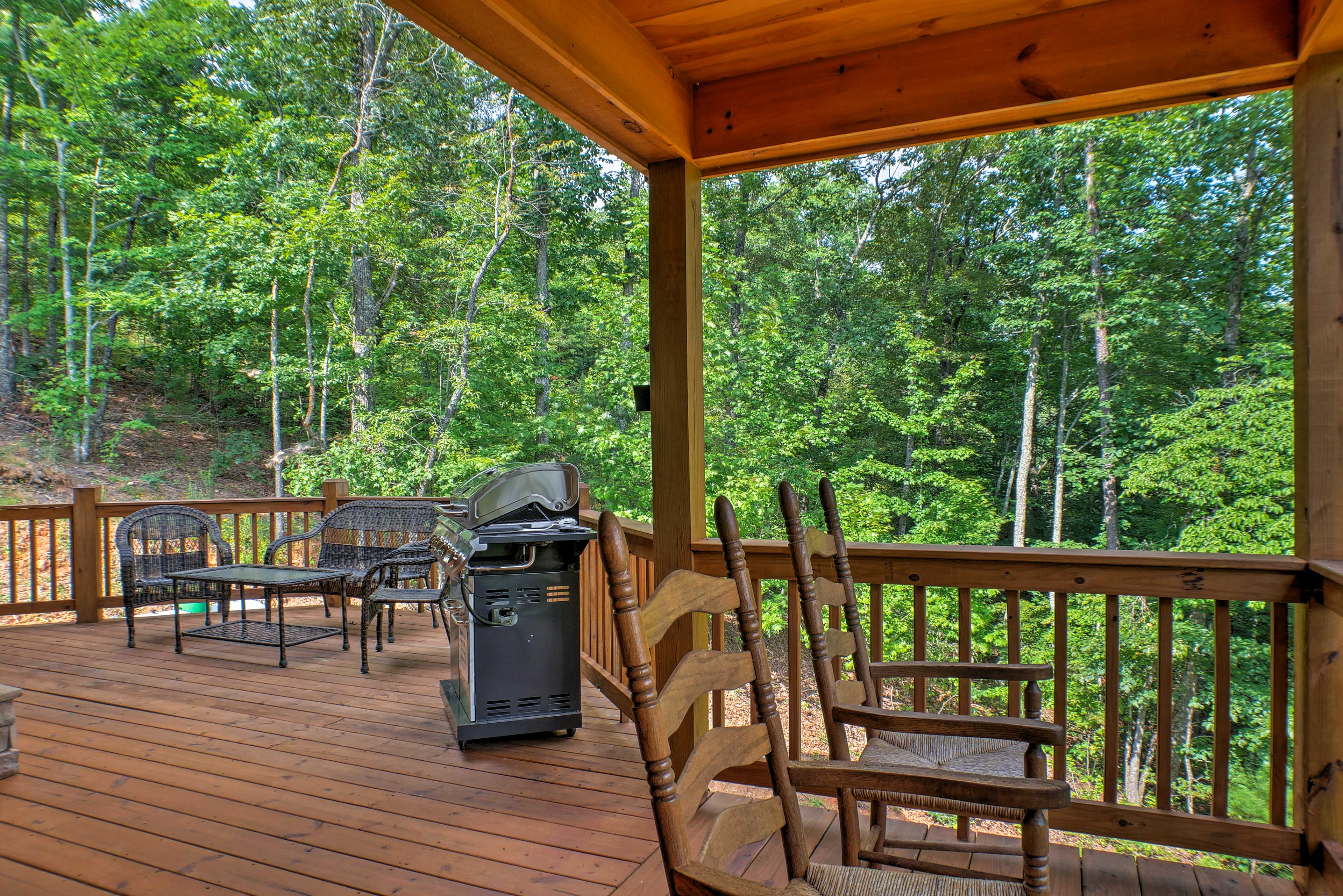 This deck includes ample seating and a gas grill.