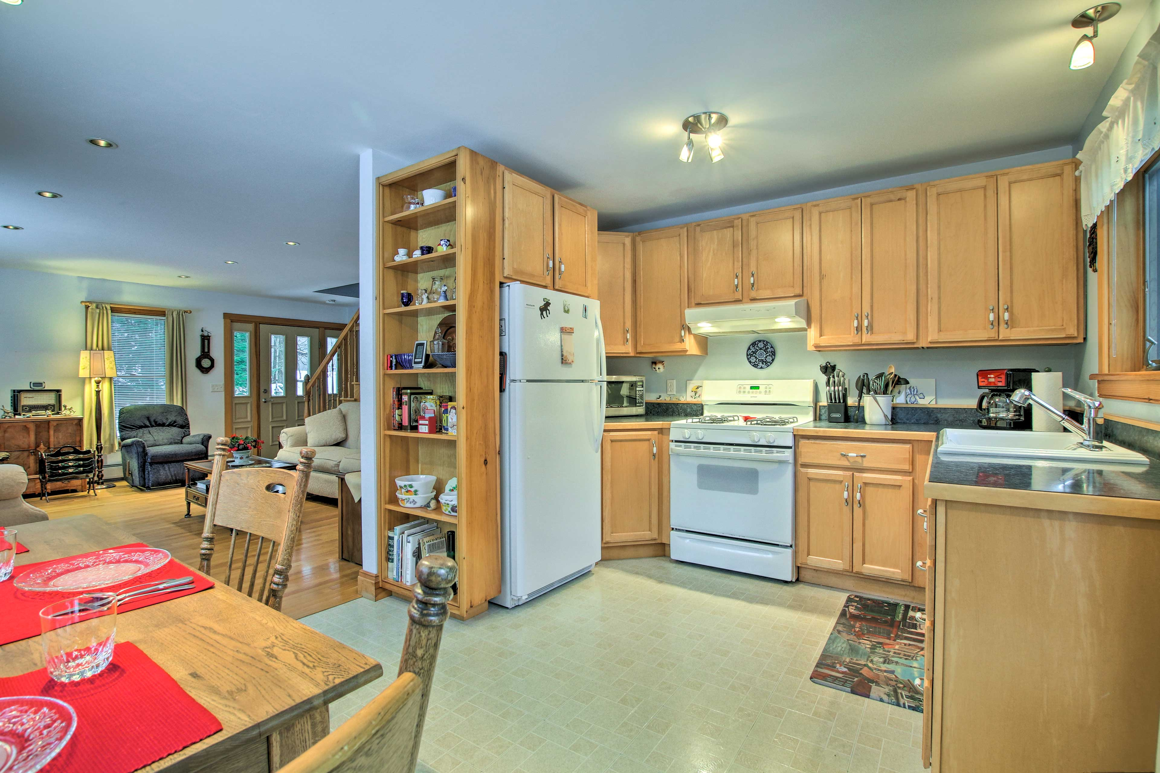 The living room flows into the well-equipped kitchen and dining area.
