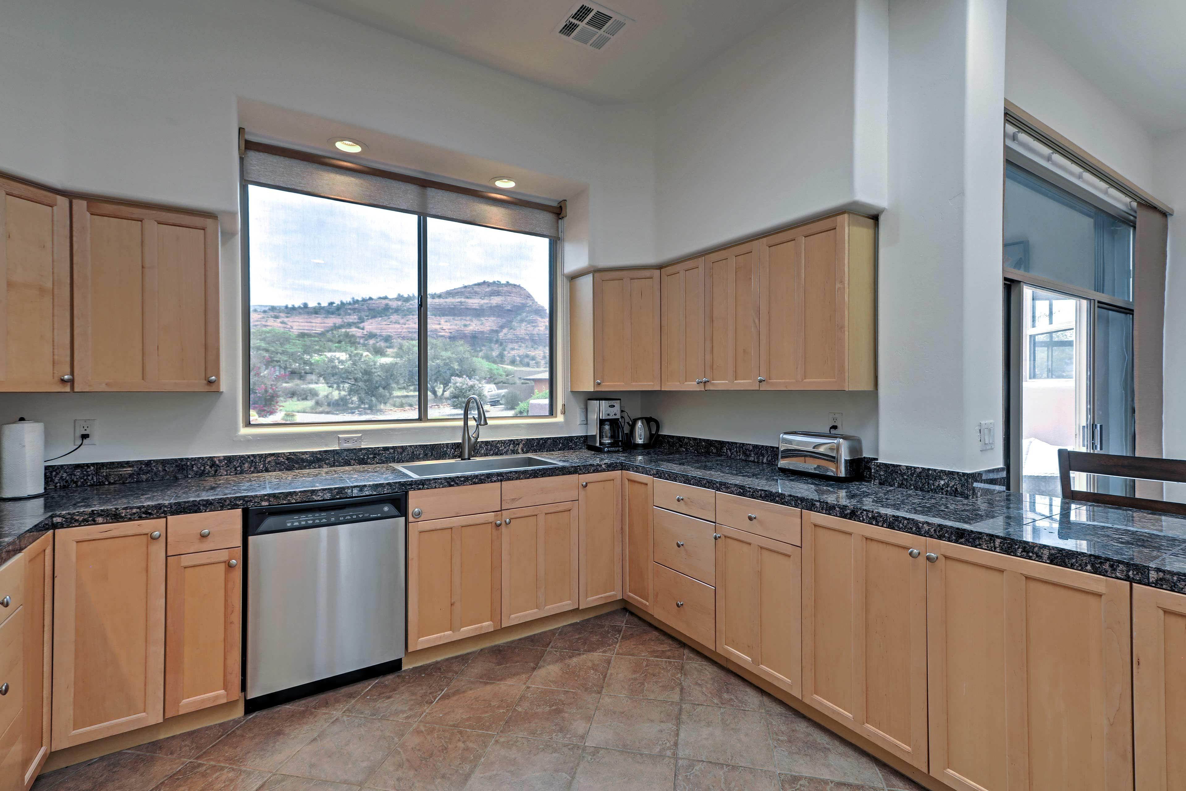 Large picture windows reveal red rock formations in the kitchen.