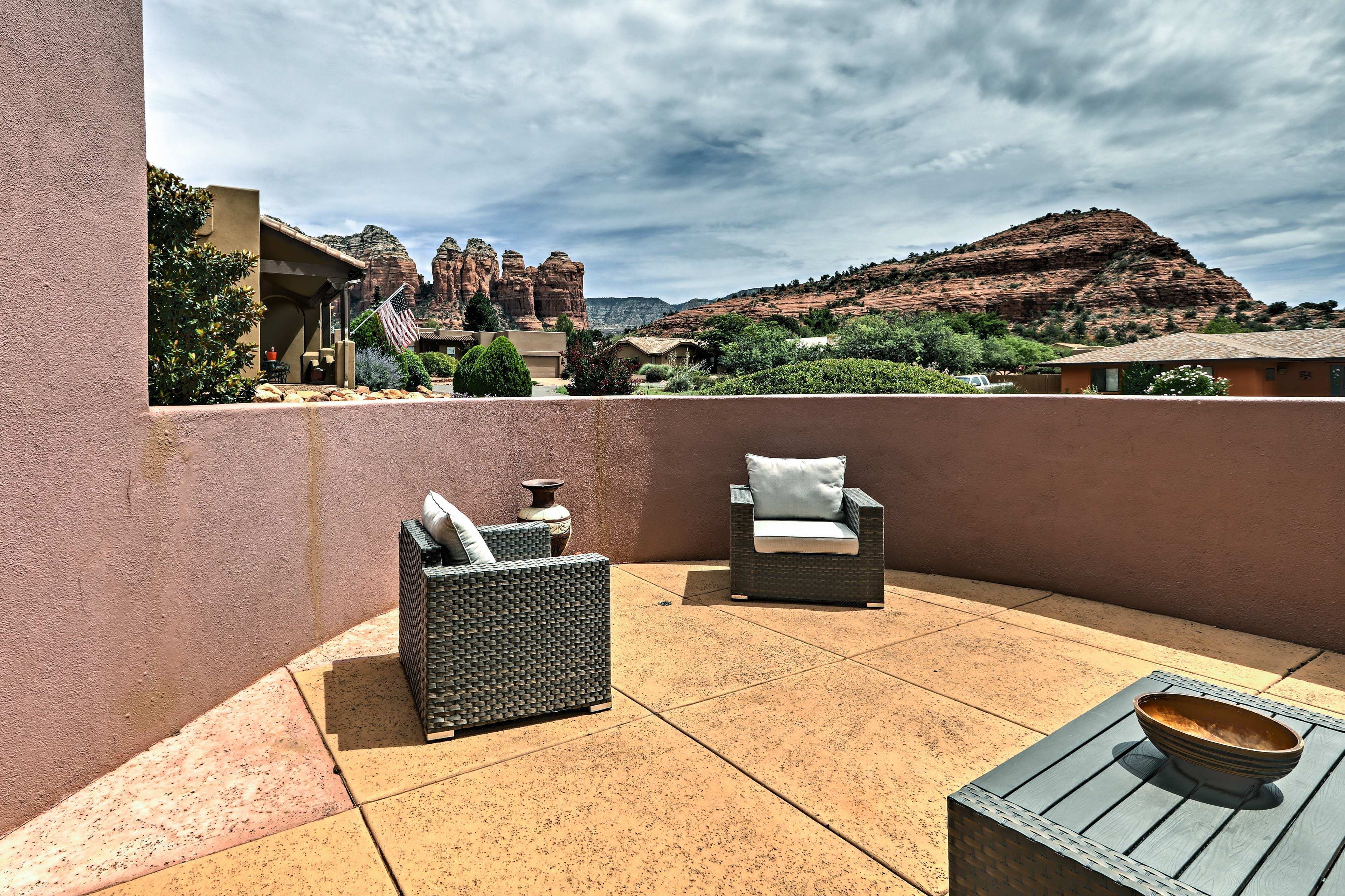 Admire the surrounding scenery from this furnished outdoor space.