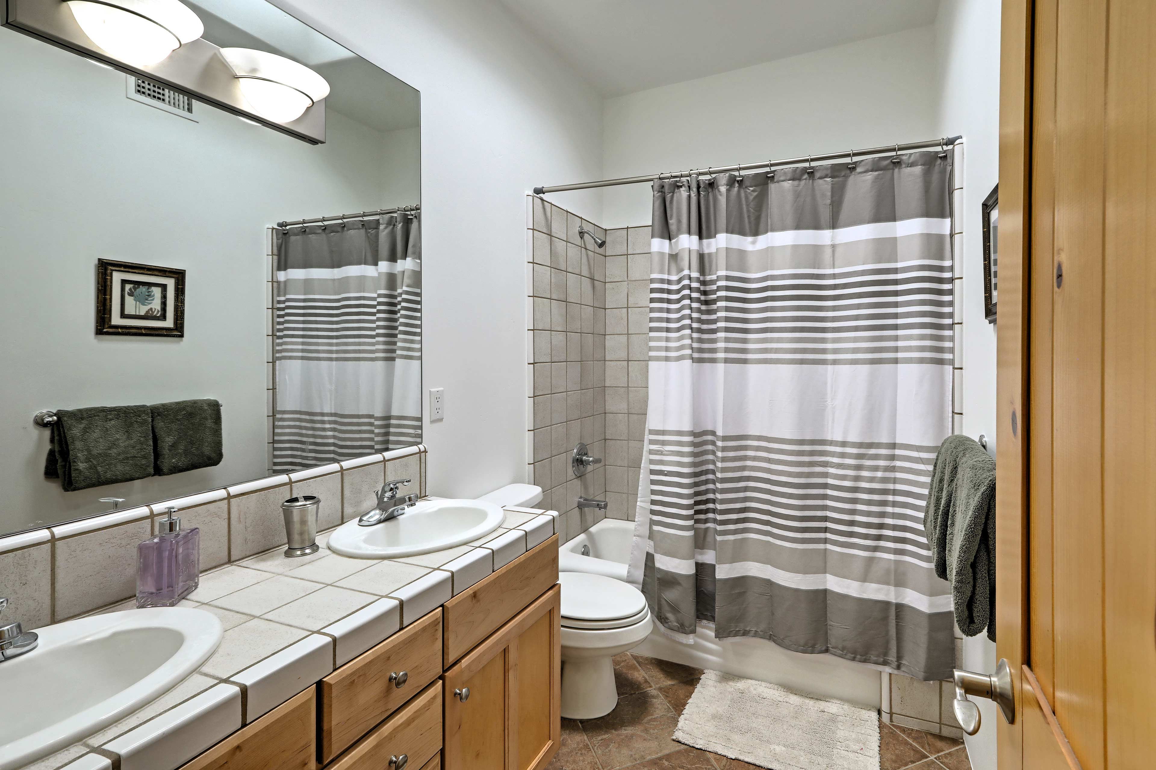 After a long day on the trails, refresh in this full bathroom.