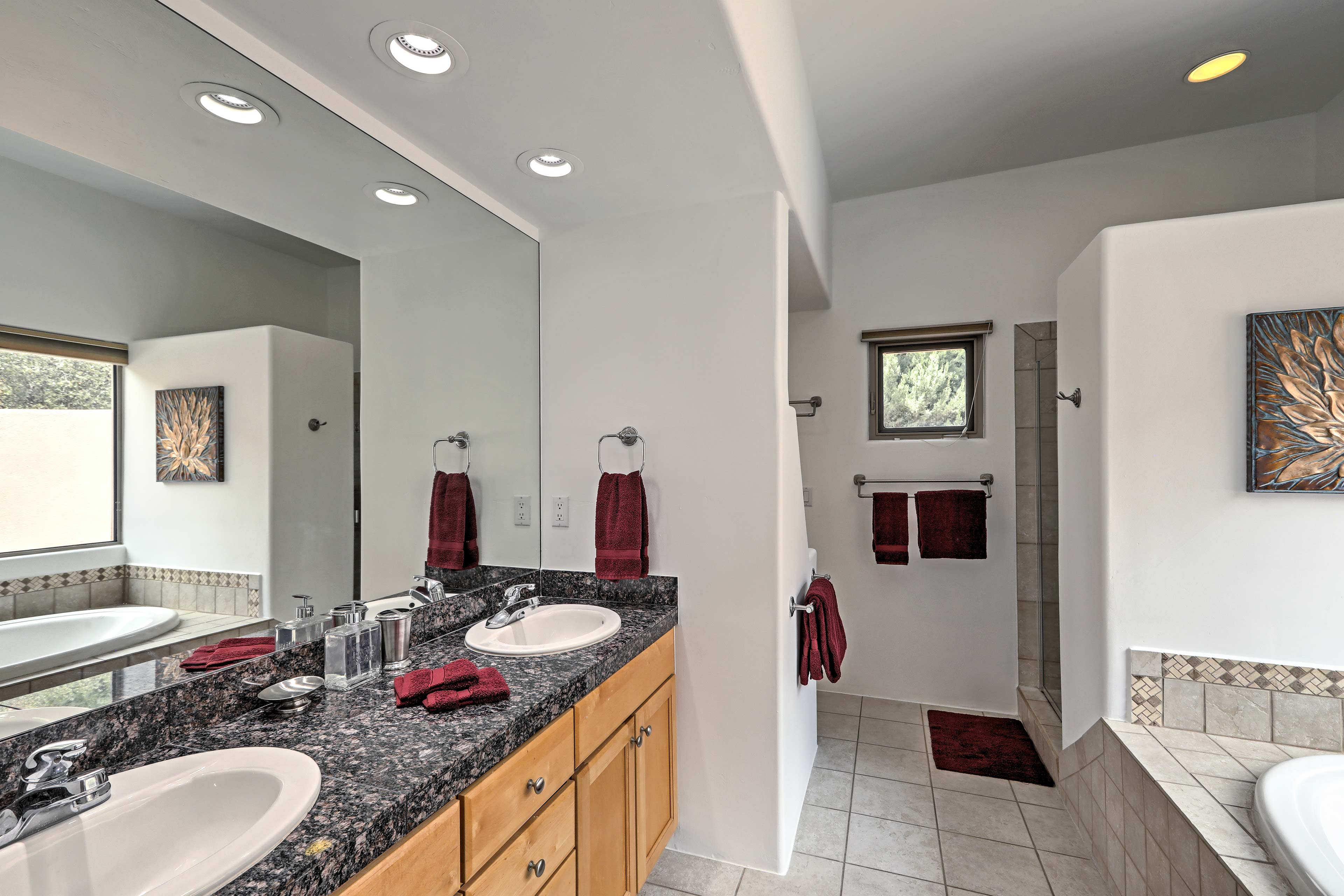 You're sure to be impressed by this spacious master en-suite bathroom!