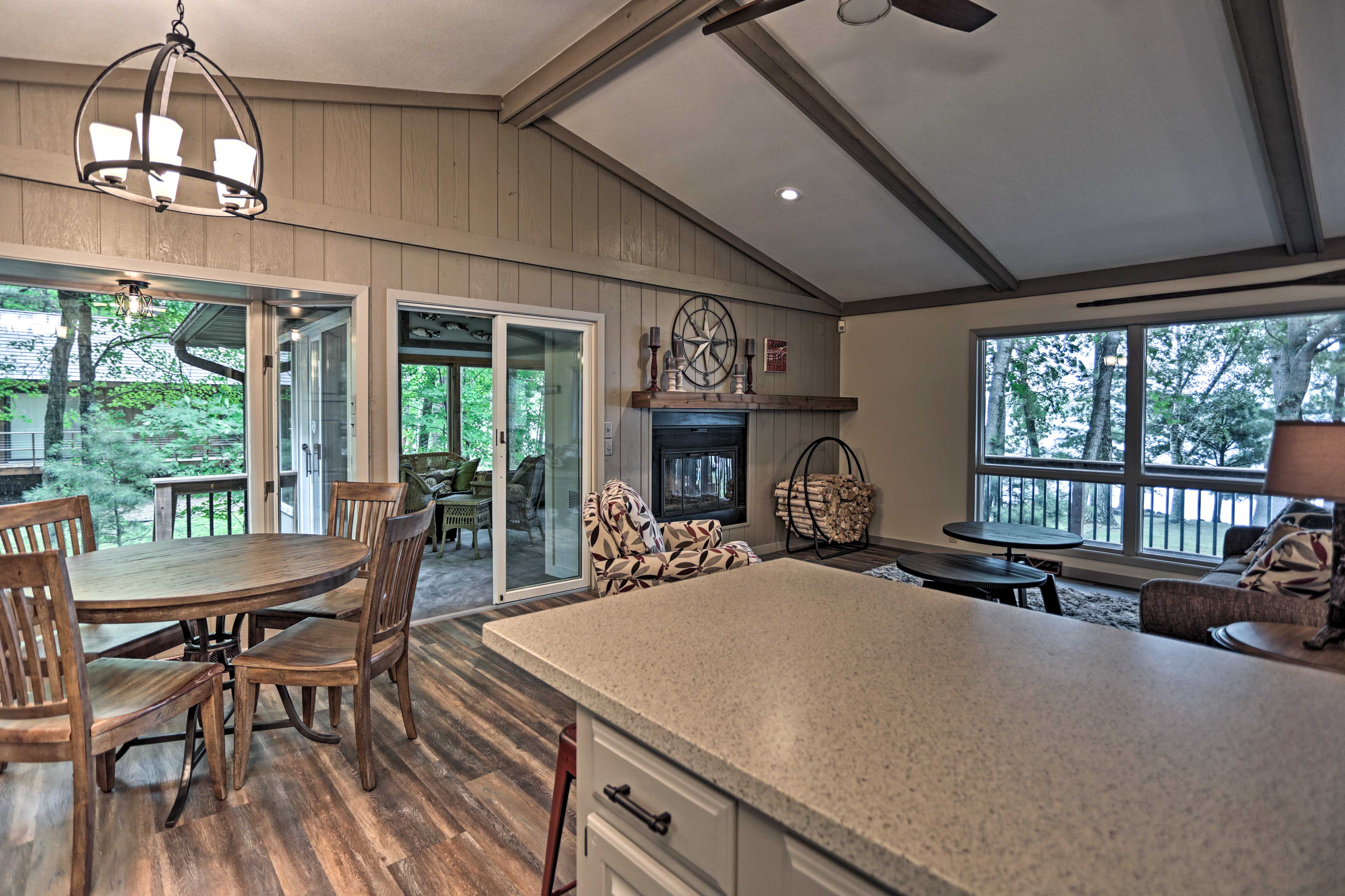 Numerous windows and sliding glass doors open to peaceful views of nature.