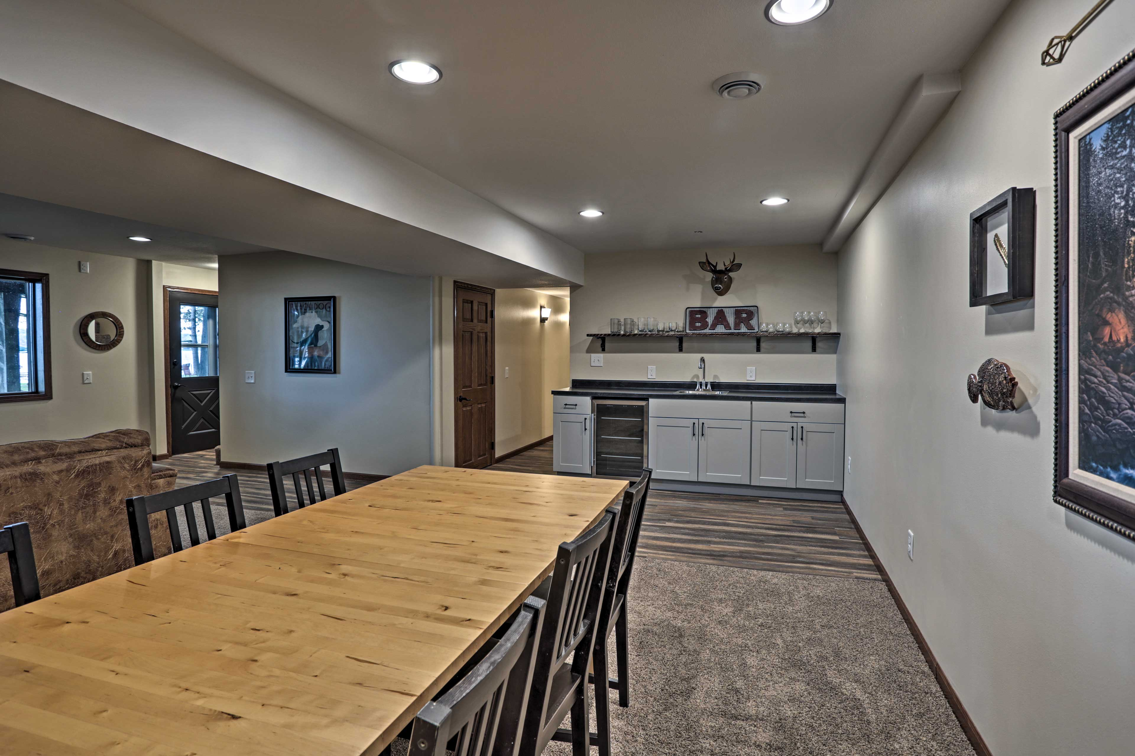 Downstairs, a massive dining room table adds more seating.