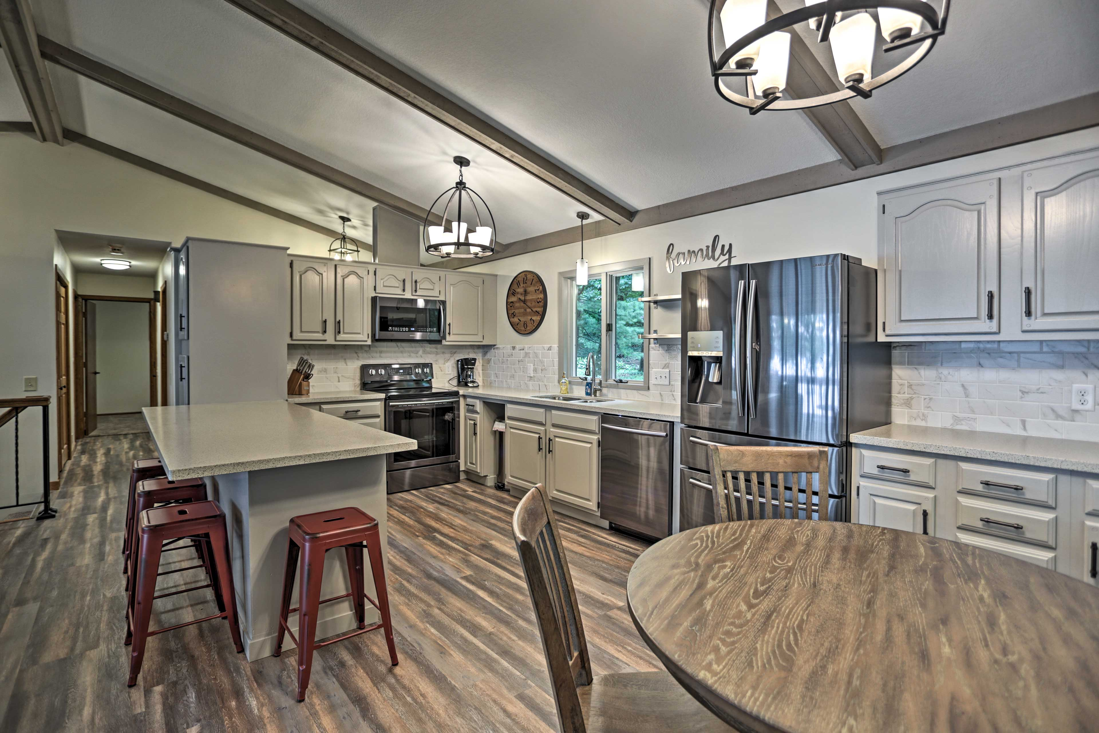 Pull up a seat to the breakfast bar beside the fully equipped kitchen.