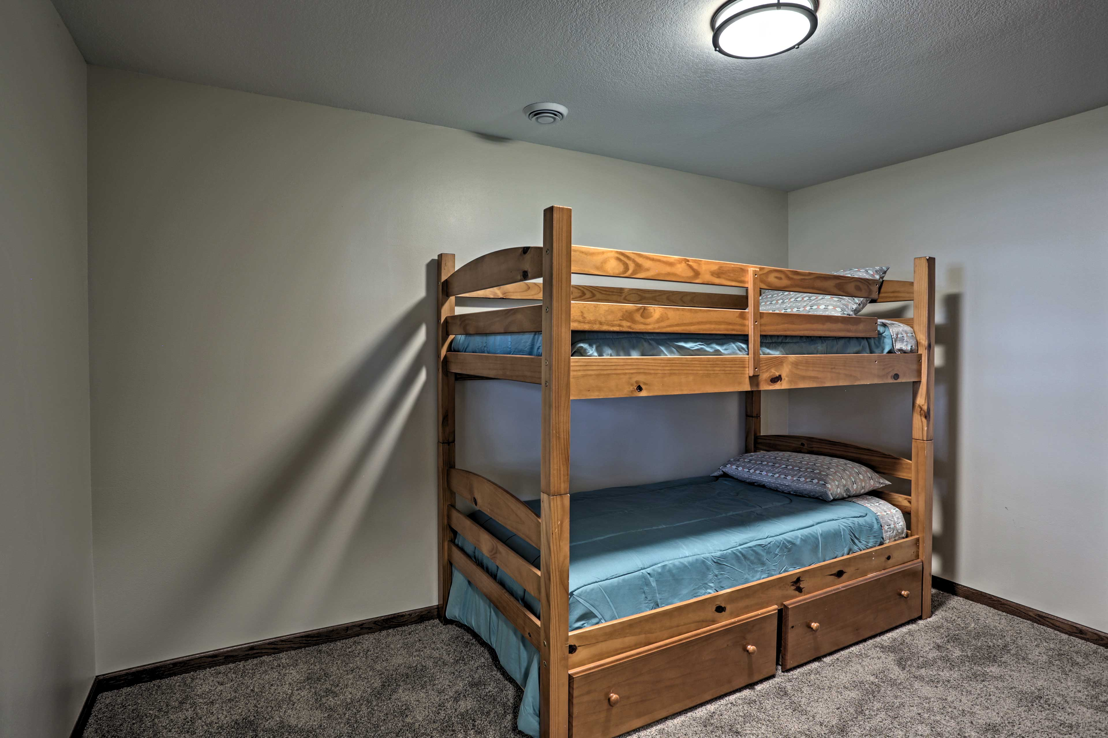 Two guests will quickly fall asleep on this twin-over-twin bunk bed.
