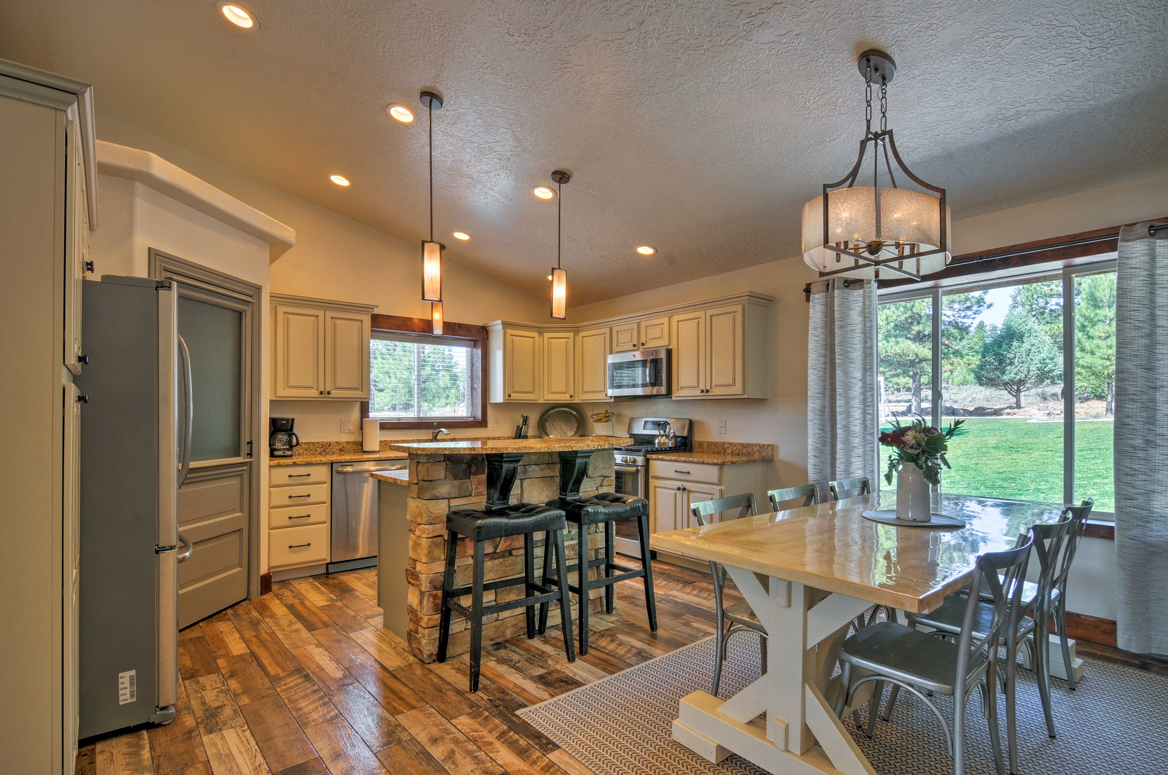 Stainless steel appliances and modern amenities complete the kitchen.