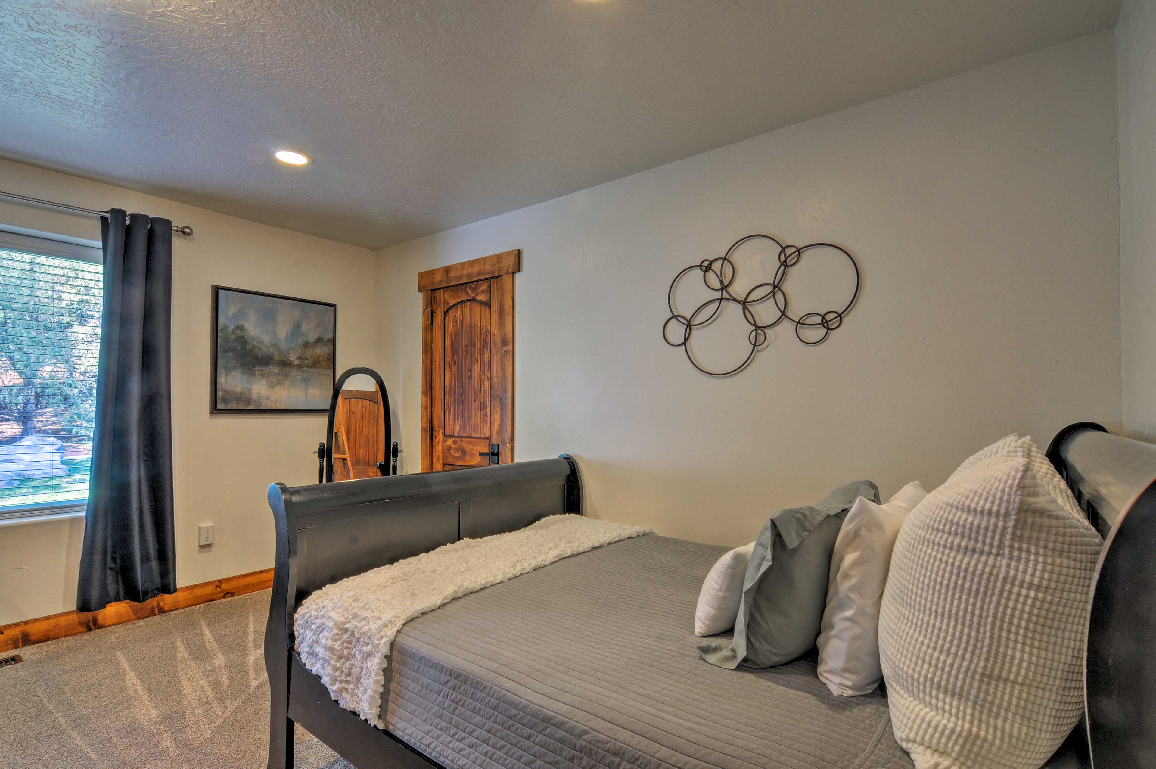 A third bedroom offers a queen-sized bed and bunk beds.