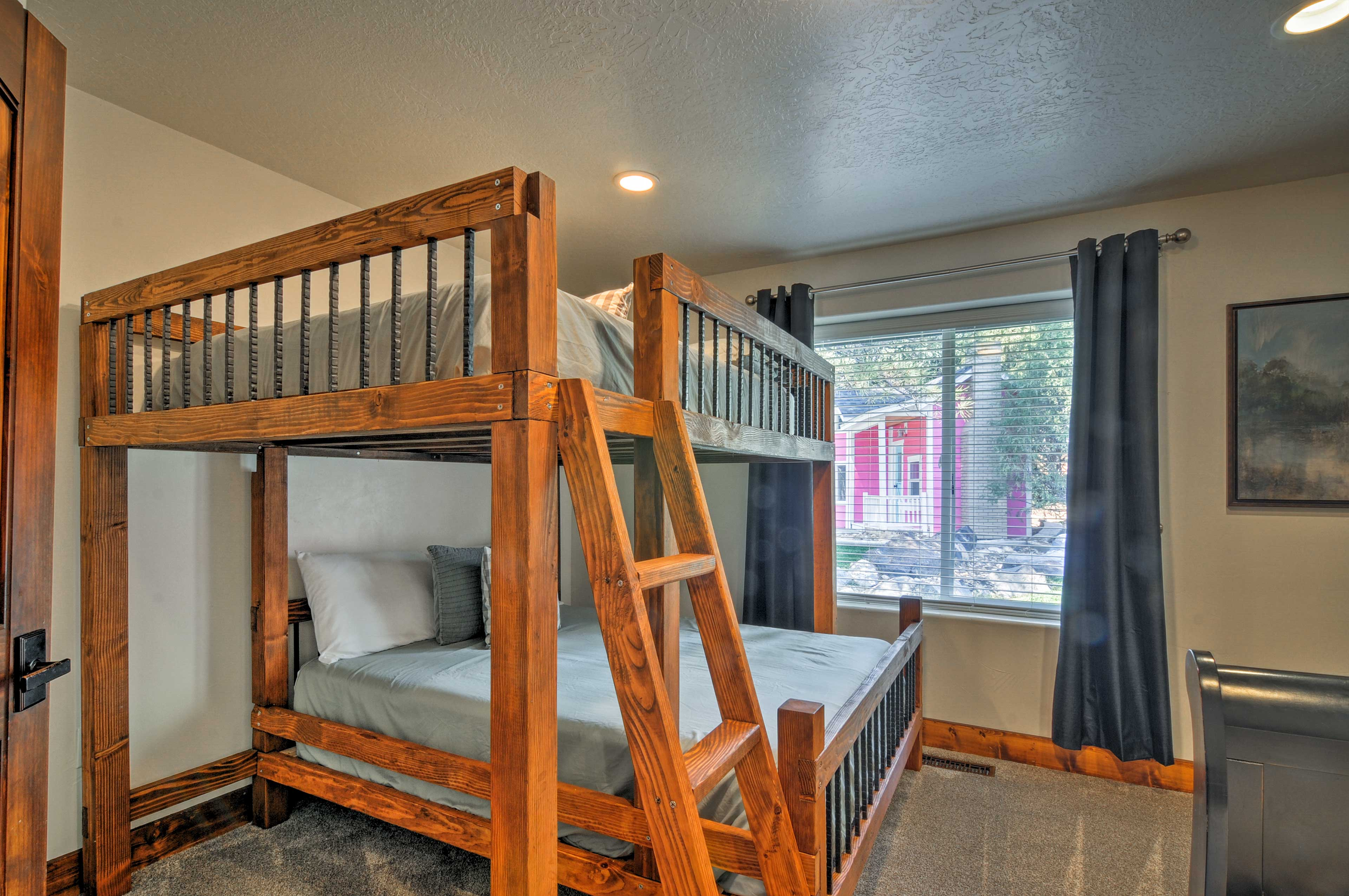 This queen-over-queen bunk bed is perfect for kids and adults alike.