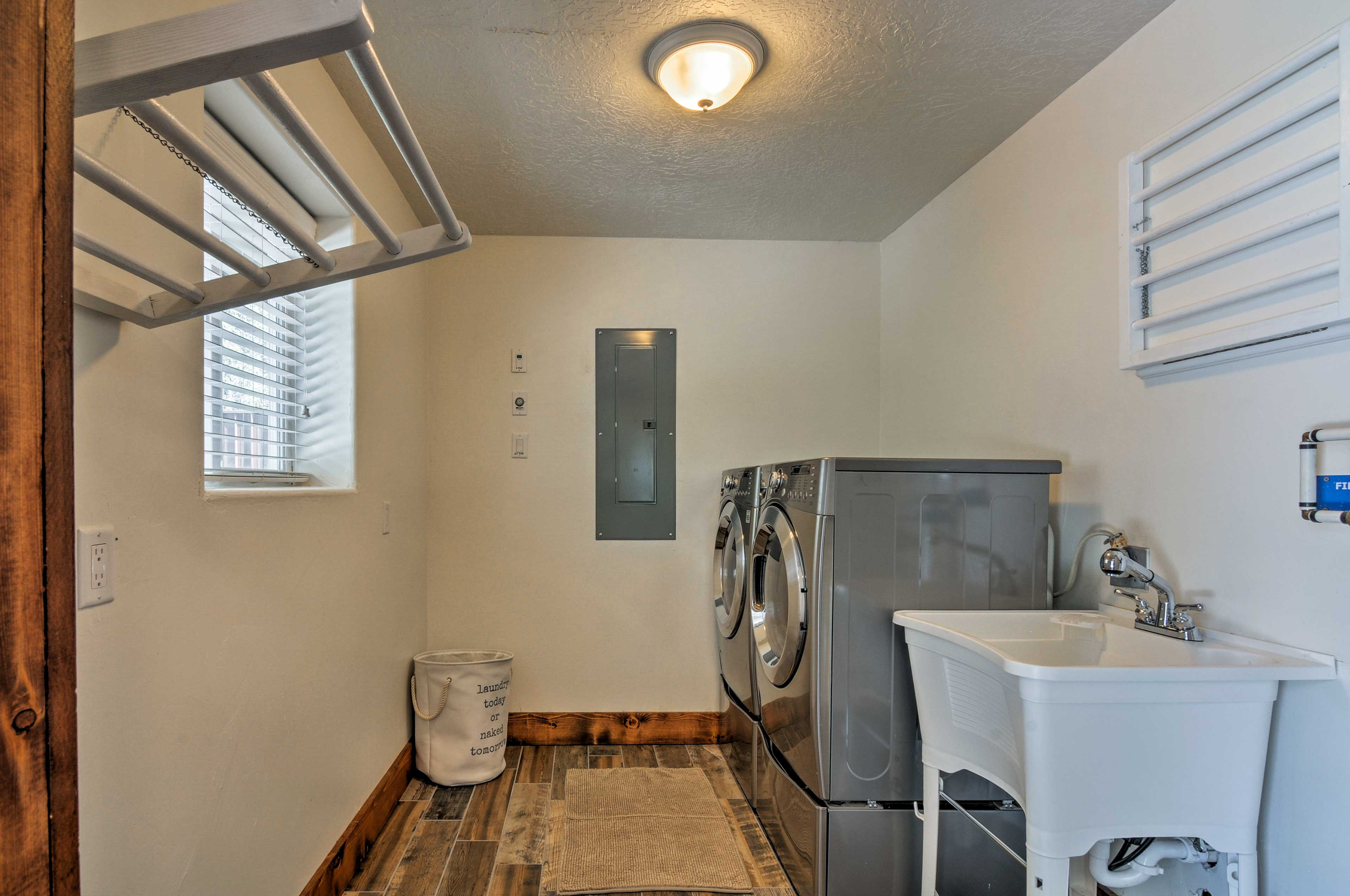 The laundry room is a welcome amenity.