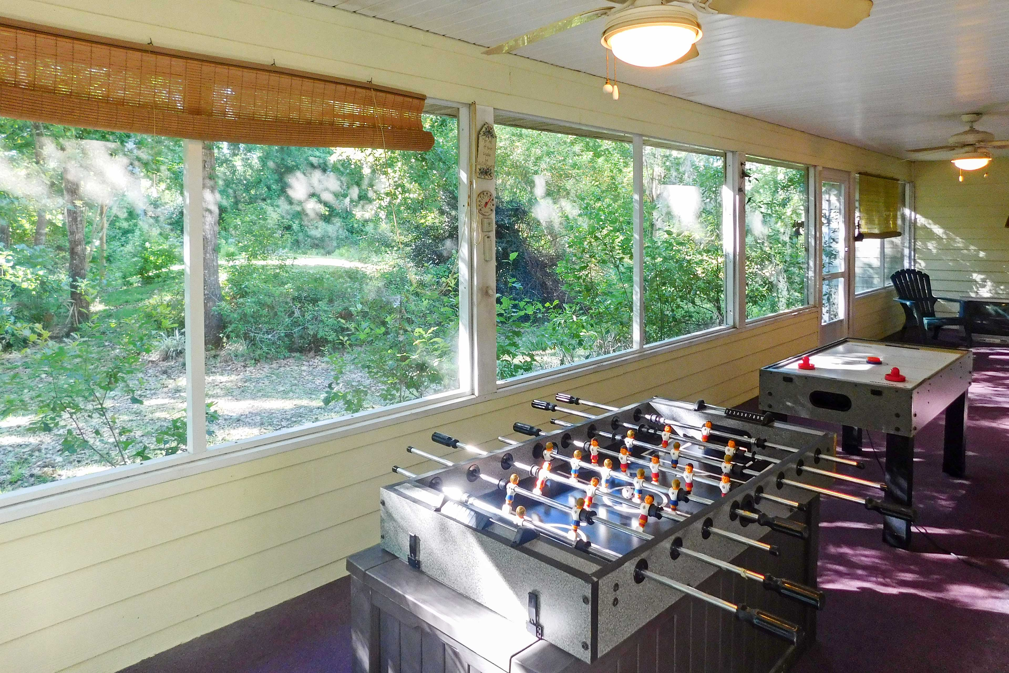 The enclosed back porch is perfect for a late movie or game night.