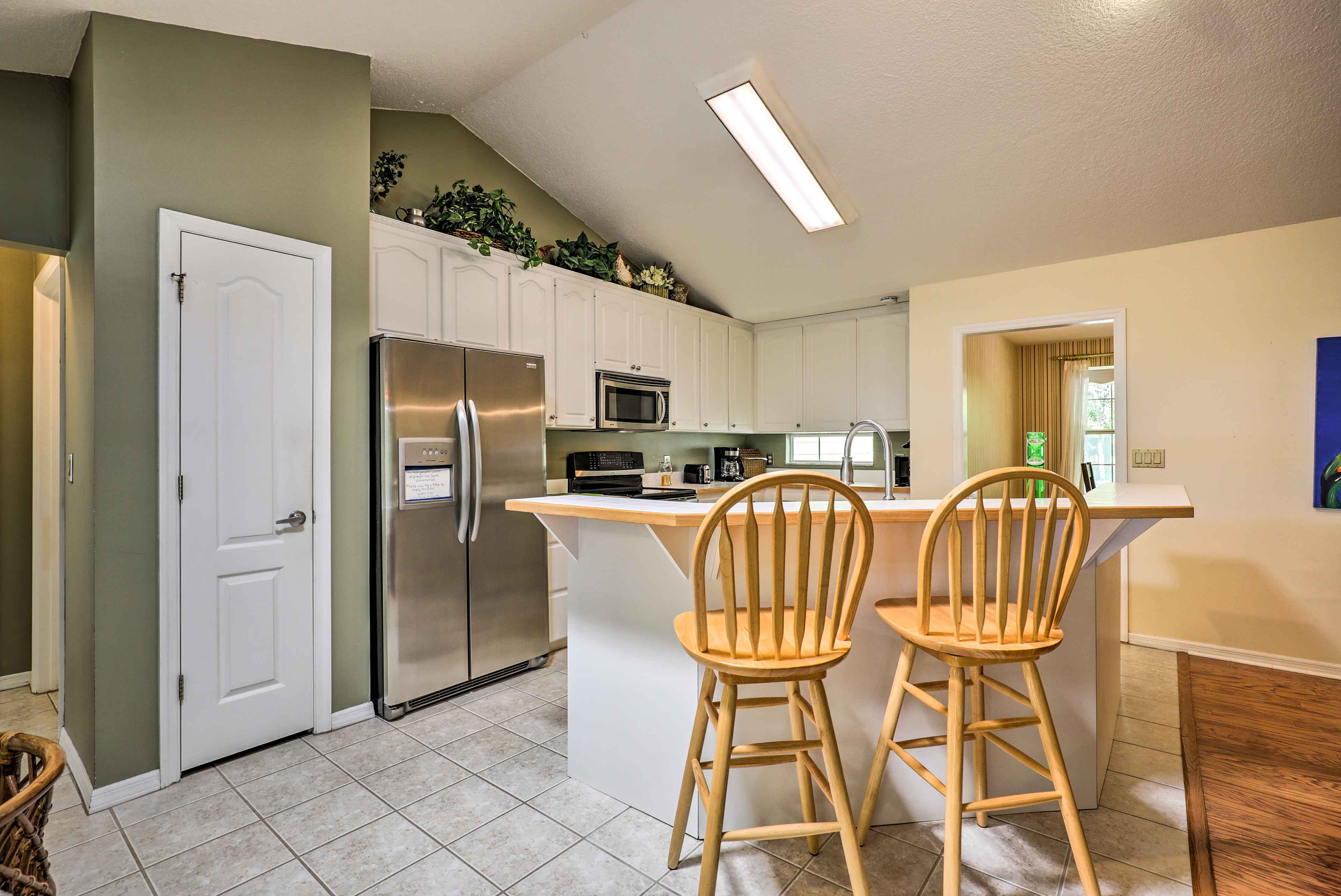 The fully equipped kitchen has ample storage and stainless steel appliances.