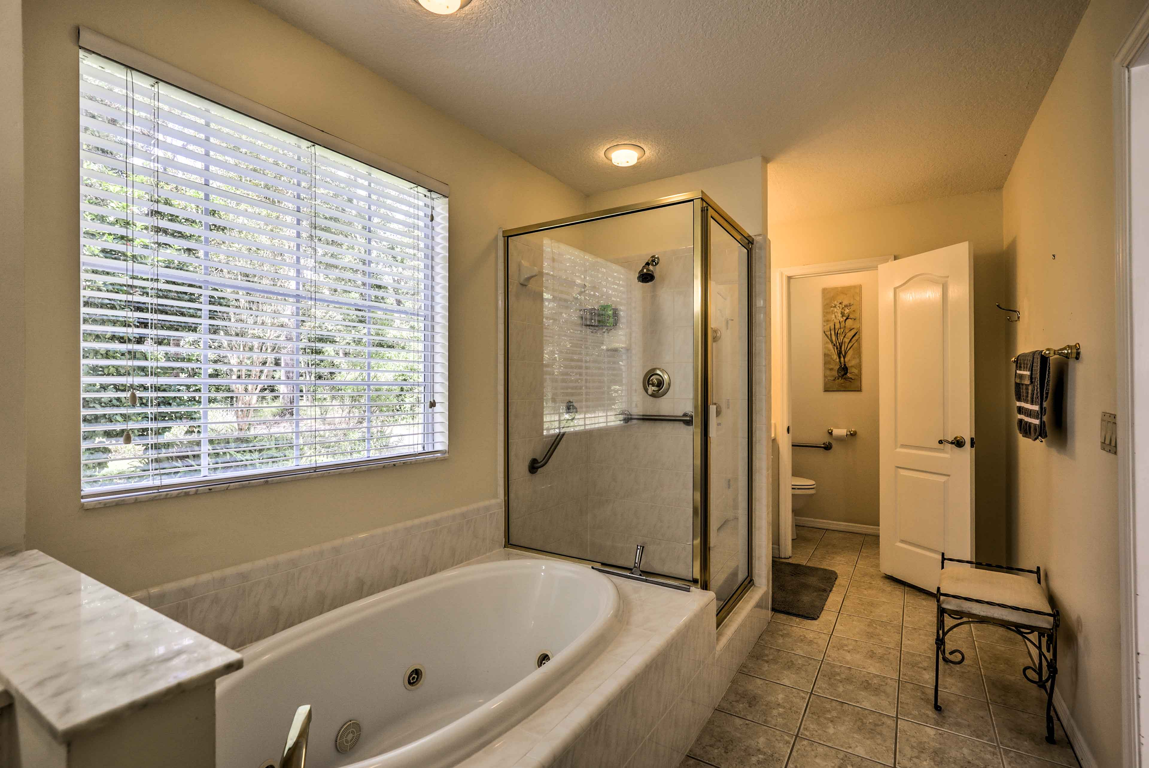 The en-suite master bathroom has a soaking tub and walk-in shower.