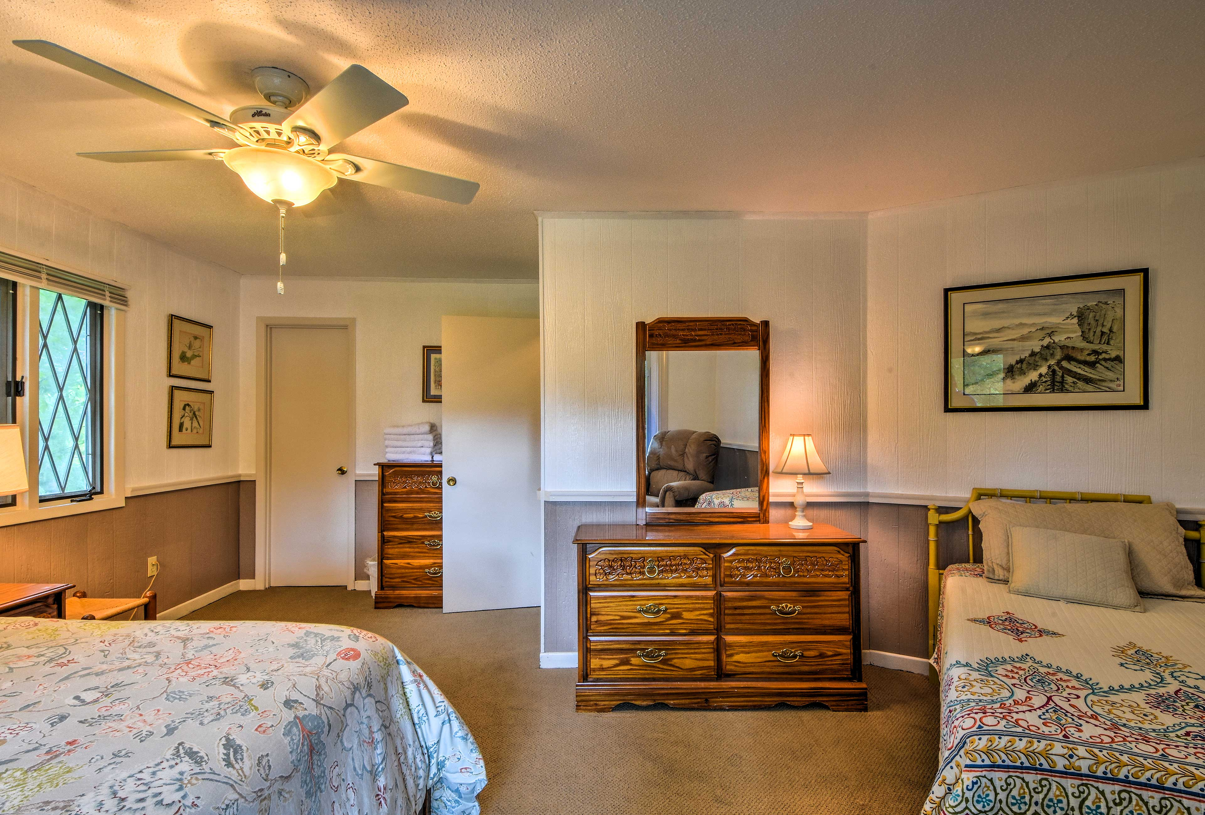 The third bedroom includes a queen bed and a twin bed.